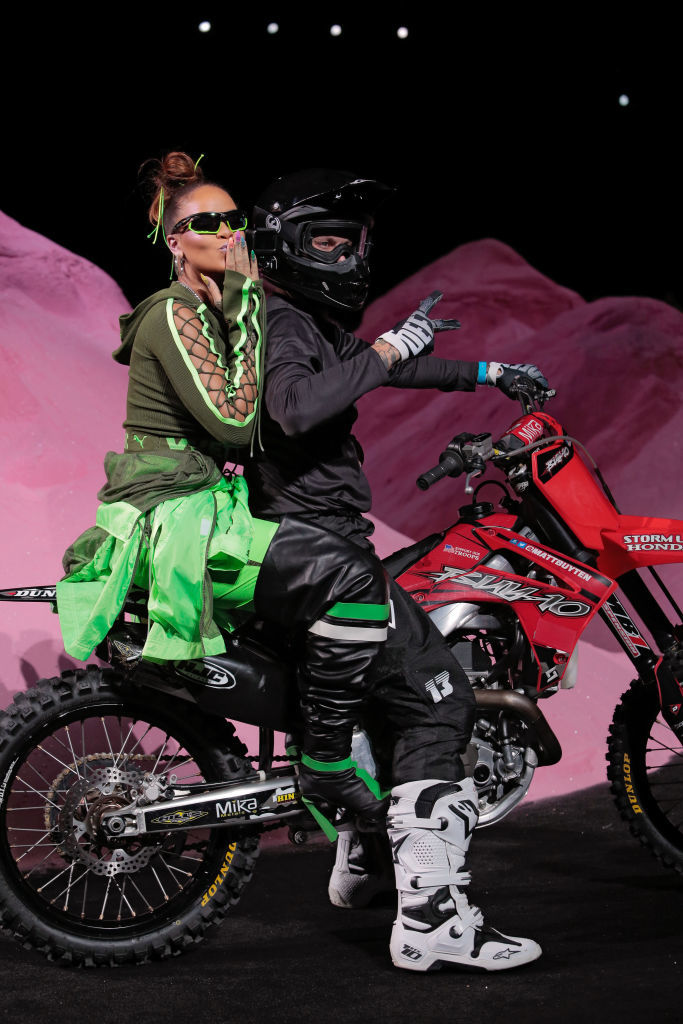 Rihanna ends her Fenty x Puma fashion show  on a dirt bike