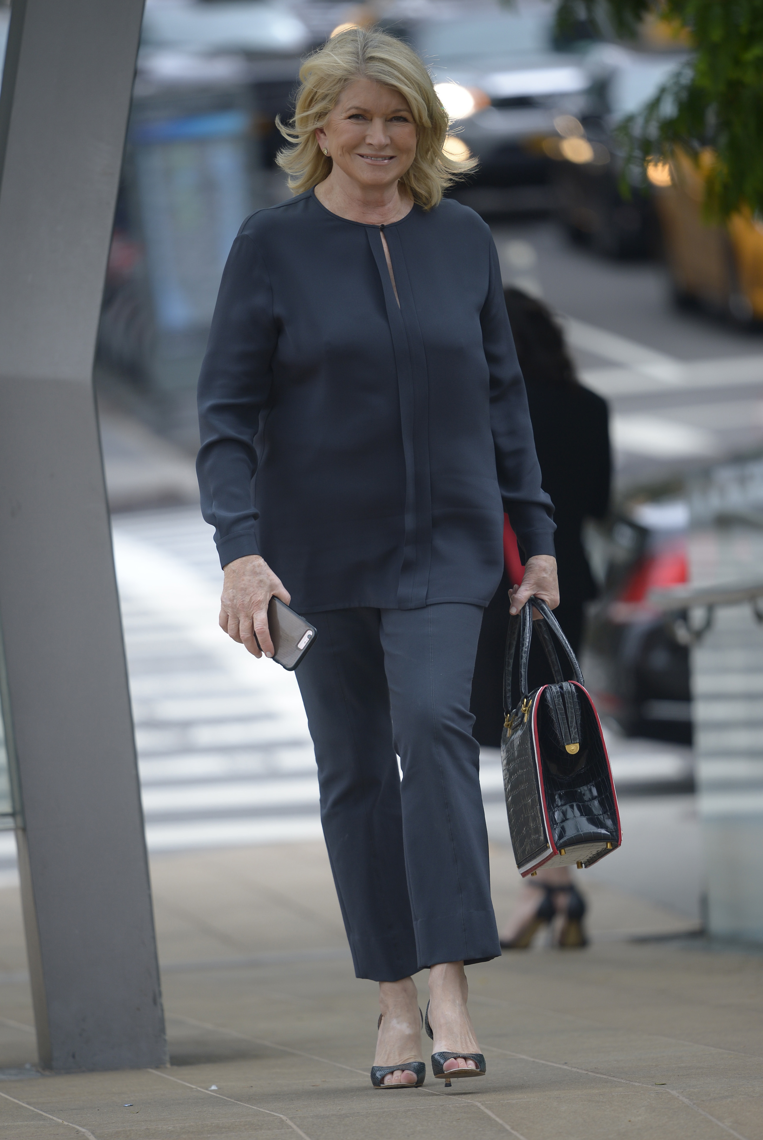 Martha Stewart totes a leather bag as she arrives at a New York Fashion Week event at the David Koch Theater in New York City on Sept. 8, 2017.