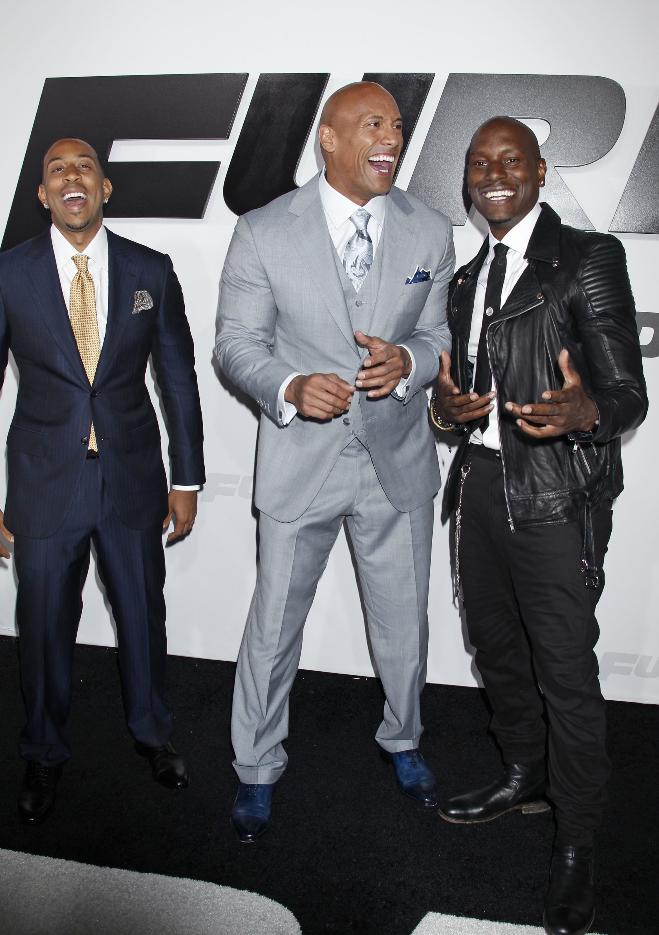 """Ludacris, Dwayne Johnson and Tyrese Gibson attend the premiere for """"Fast and Furious 7"""" in Hollywood on April 1, 2017."""