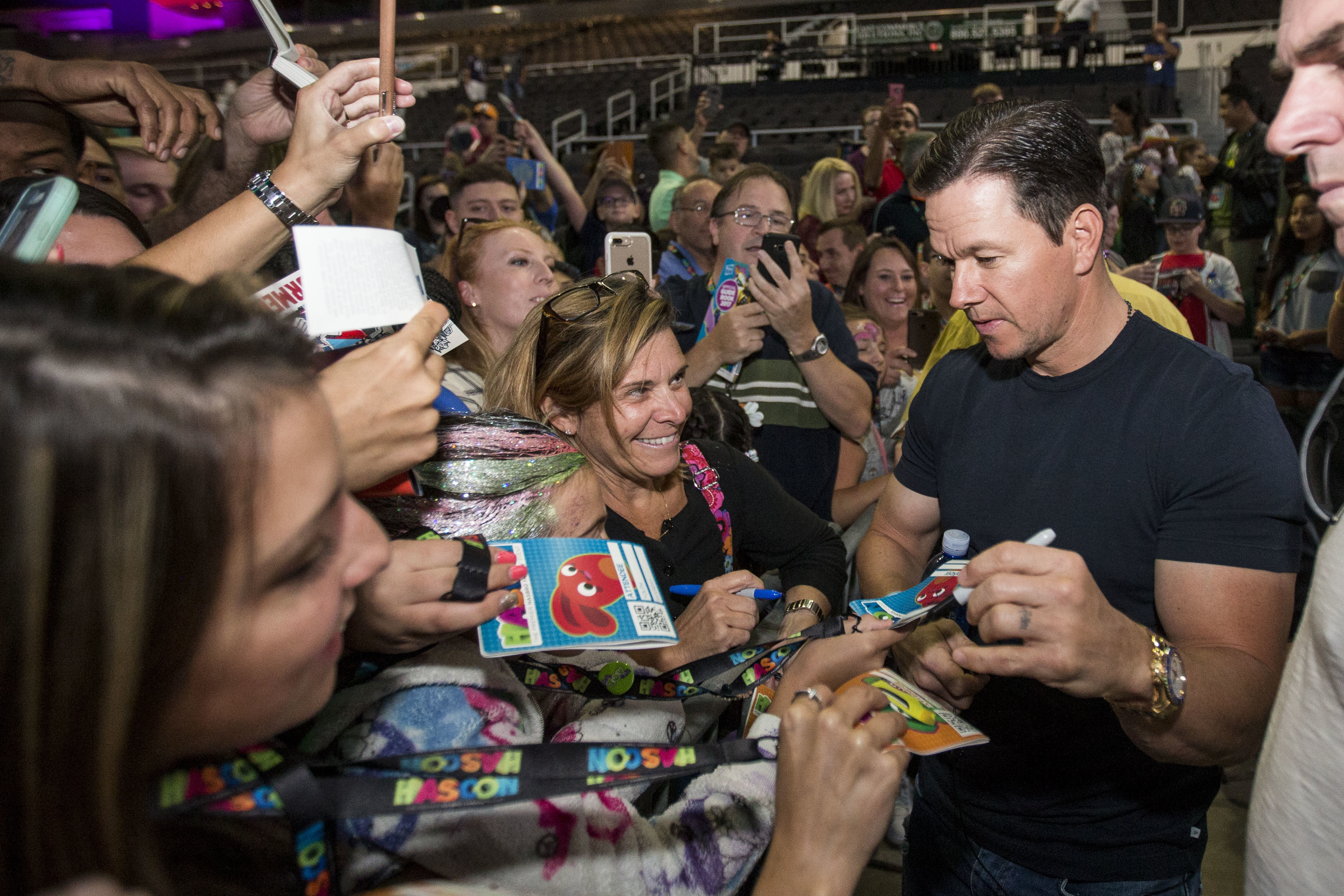 "Mark Wahlberg greets fans at a panel for ""Transformers: The Last Night Knight"" during Hasbro's HasCon event in Providence, Rhode Island, on Sept. 9, 2017."