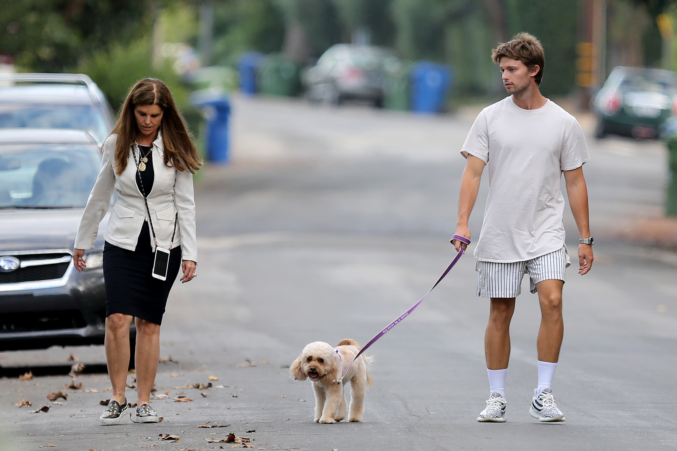 Patrick Schwarzenegger and his mother Maria Shriver were spotted taking an evening stroll with his furry friend while out in the Brentwood neighborhood of Los Angeles on Sept. 11, 2017.
