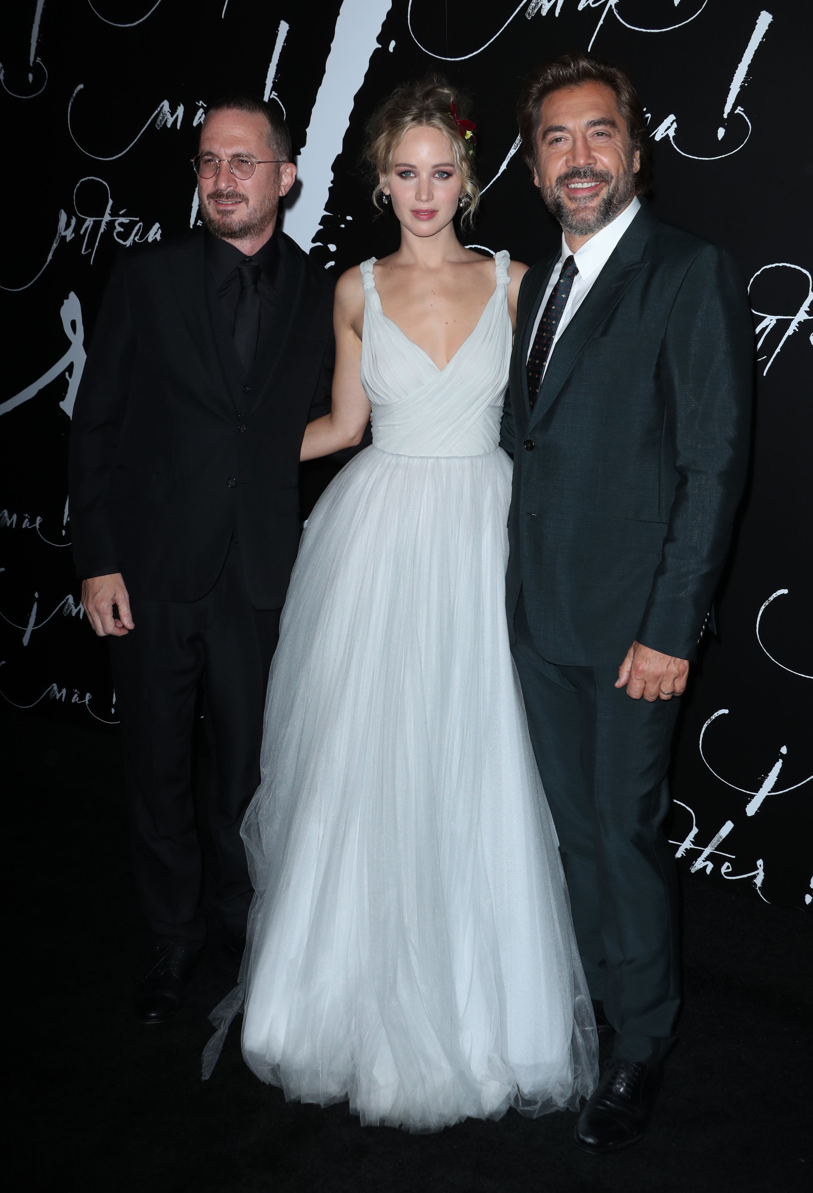 """Darren Aronofsky, Jennifer Lawrence and Javier Bardem attend the """"Mother!"""" premiere in New York City on Sept. 13, 2017."""
