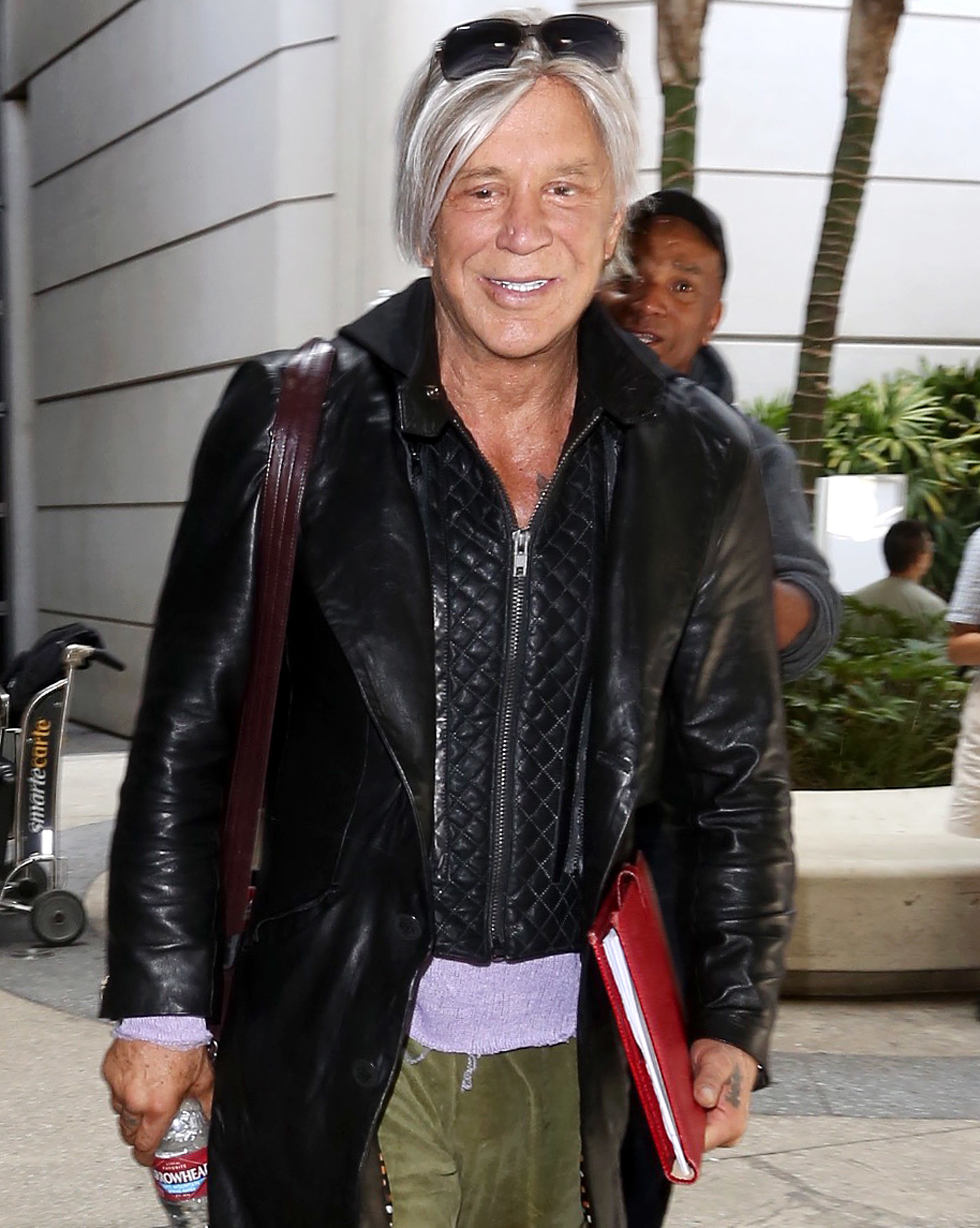 Mickey Rourke arrives at Los Angeles International Airport on Aug. 11, 2017.