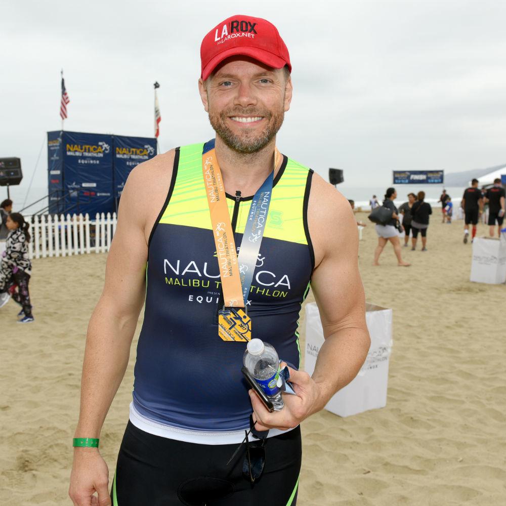 Joel McHale participates in the Nautica Malibu Triathlon at Zuma Beach in Malibu, Calif., on Sept. 17, 2017.