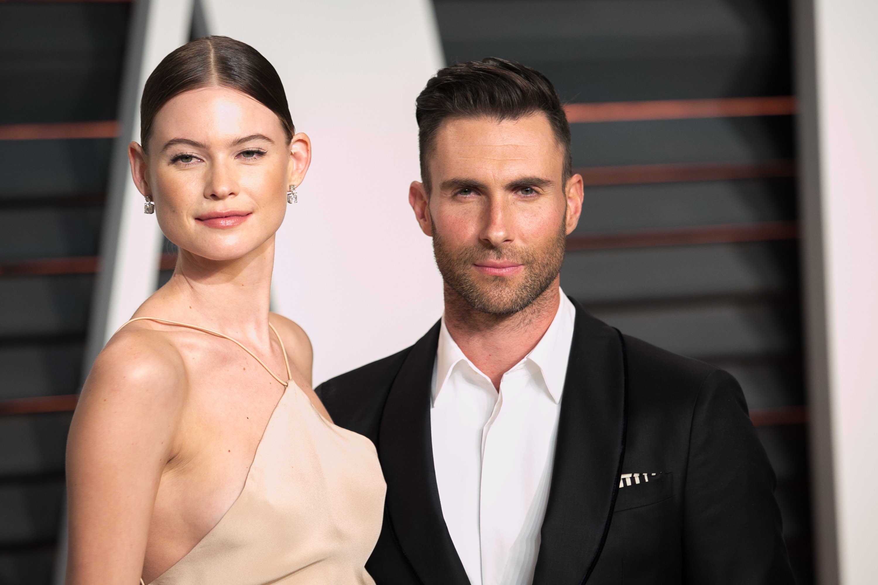 Behati Prinsloo and Adam Levine attends the 2015 Vanity Fair Oscar Party in Los Angeles on Feb. 22, 2015.