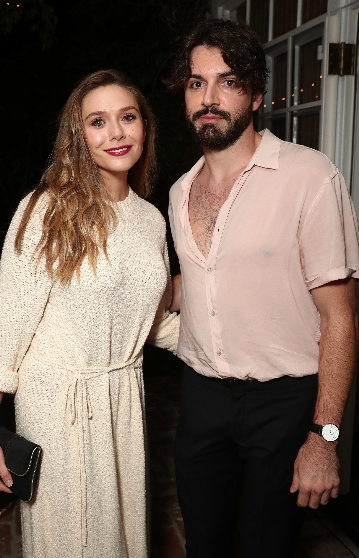 Elizabeth Olsen and Robbie Arnett attend the Gersh Pre Emmy Party in Los Angeles on Sept. 15, 2017.