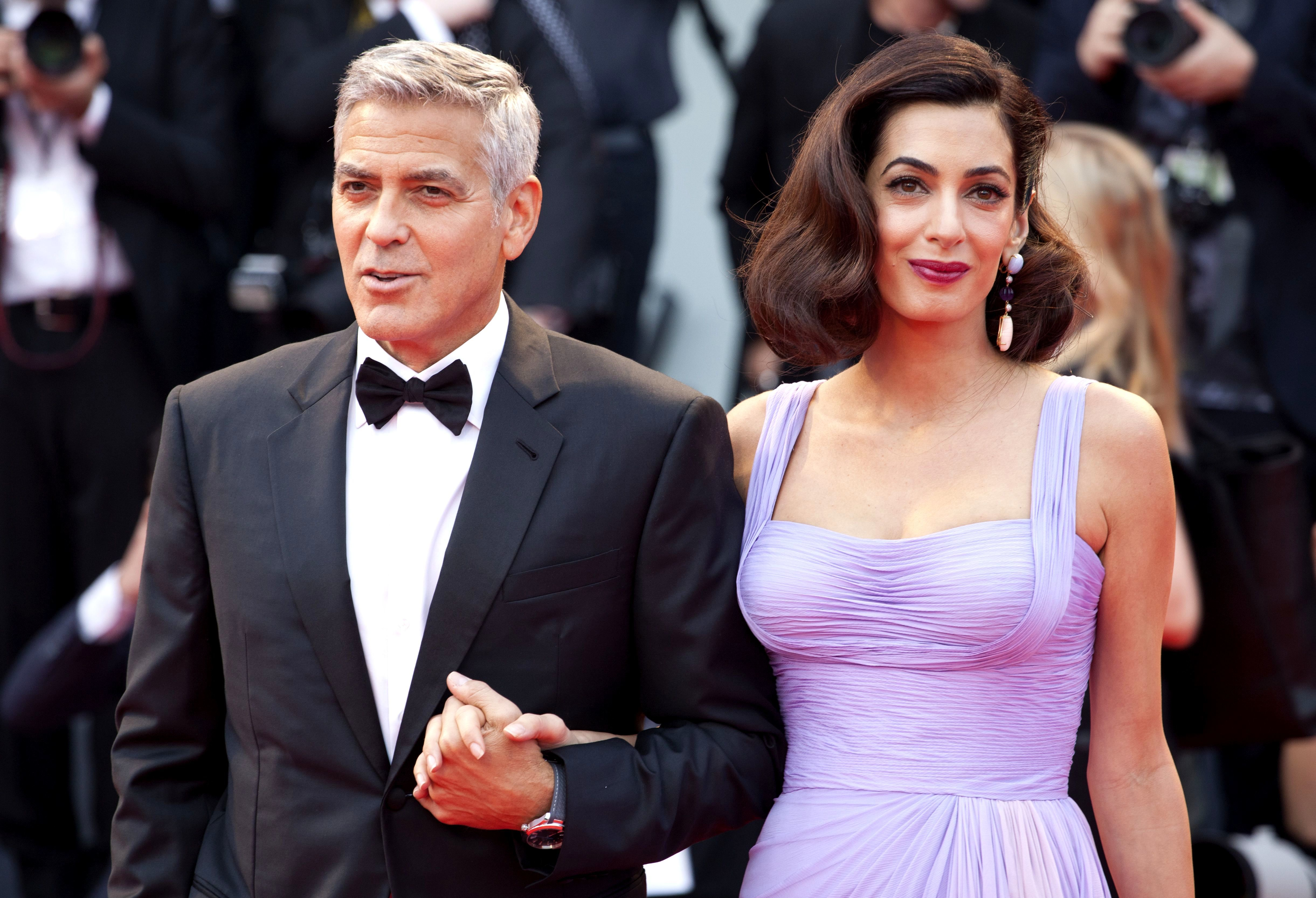 "George Clooney and Amal Clooney attend the ""Suburbicon"" premiere at the 74th Venice International Film Festival on Sept. 2, 2017."