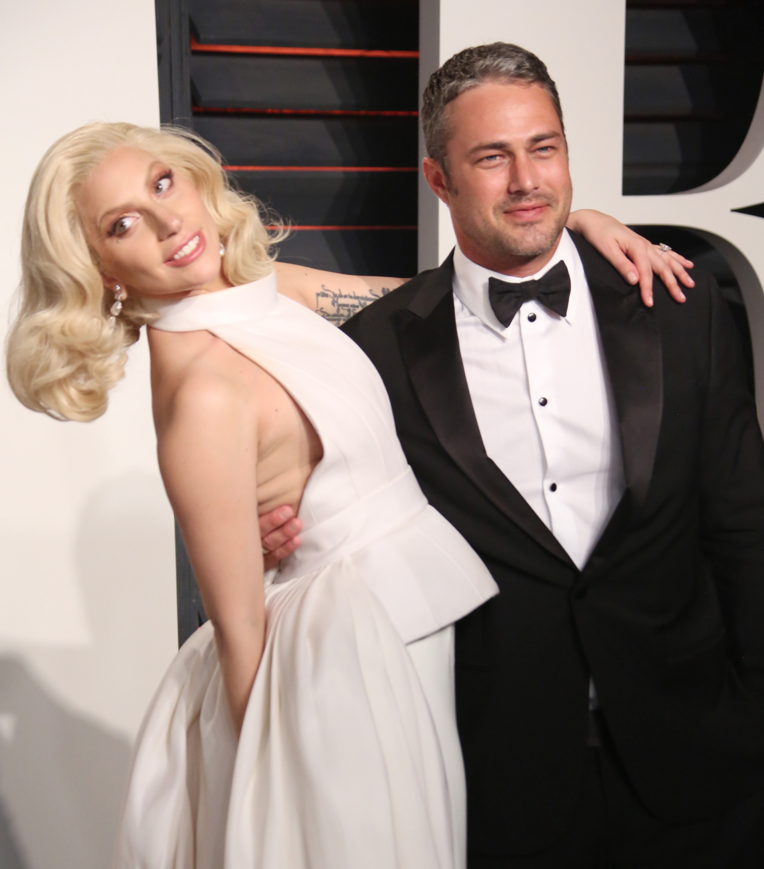 Lady Gaga and Taylor Kinney attend the 88th Annual Academy Awards in Los Angeles on Feb. 28, 2016.