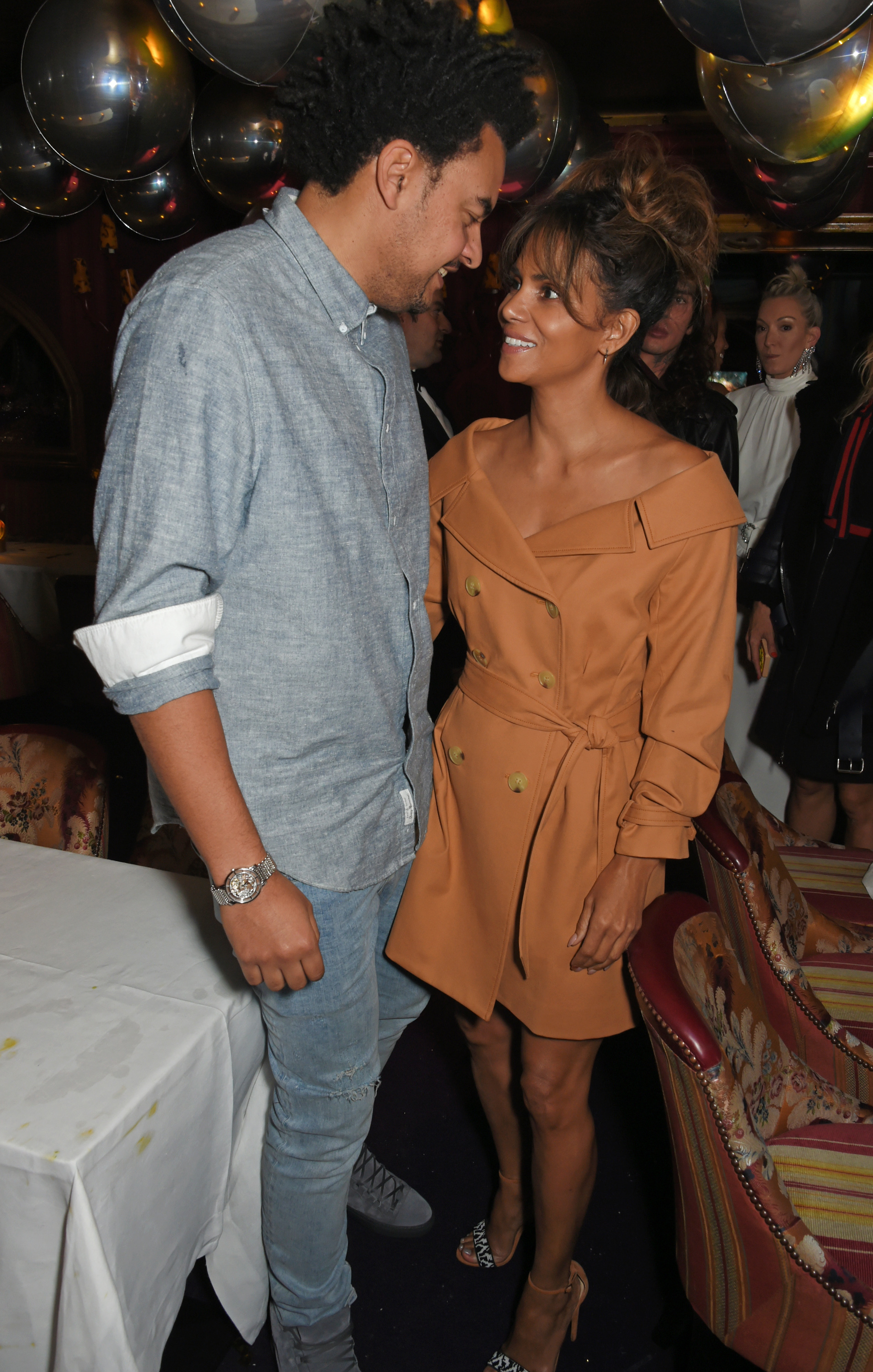 """It's Insta official! Halle Berry (51) and British music producer, Alex Da Kid (35) made their relationship public on Tuesday September 19th with an adorable black and white photo of the pair. """"My balance,"""" Berry captioned the photo. The same day, People Magazine reported seeing the two hand in hand in London entering a restaurant for a romantic date night."""