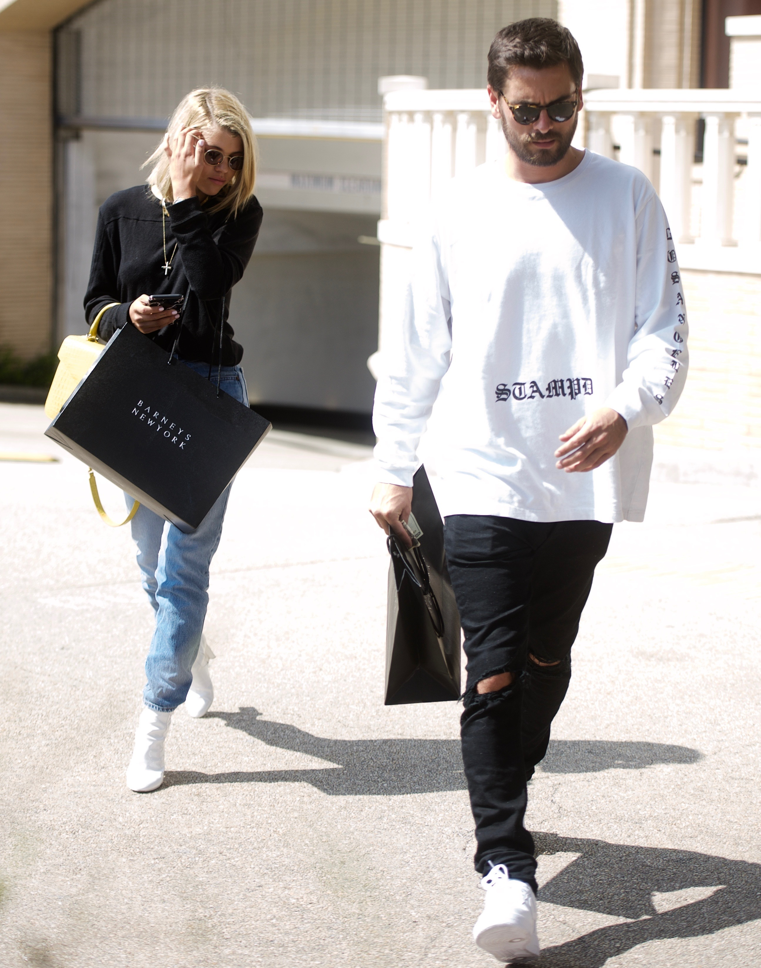 Sofia Richie and Scott Disick are seen leaving from shopping at Barney's NYC in Beverly Hills, Los Angeles on Sept. 14, 2017.