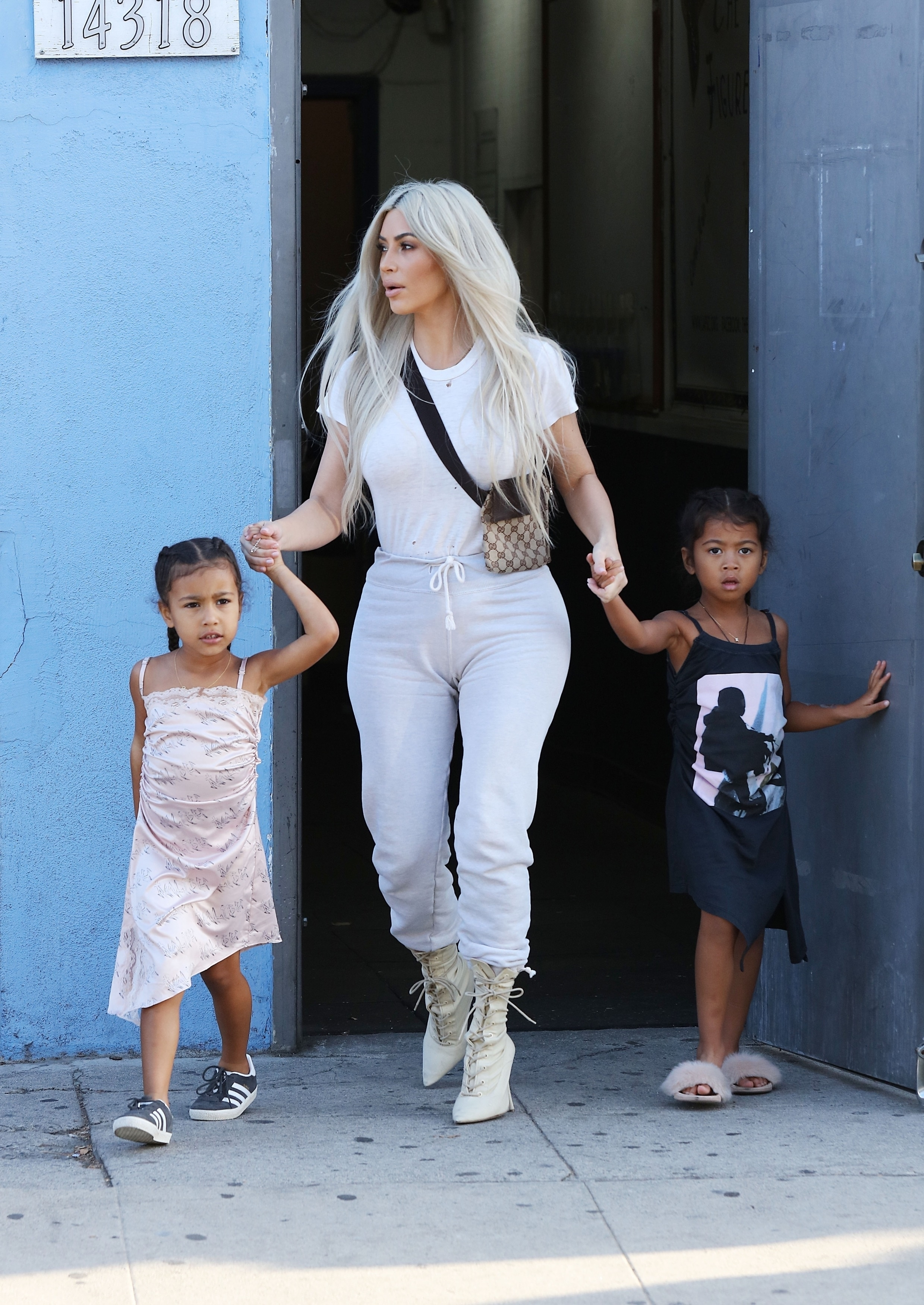 Kim Kardashian and Kanye West exit Iceland Ice Skating Center in Van Nuys with their children North and Saint West on Sept. 21, 2017 