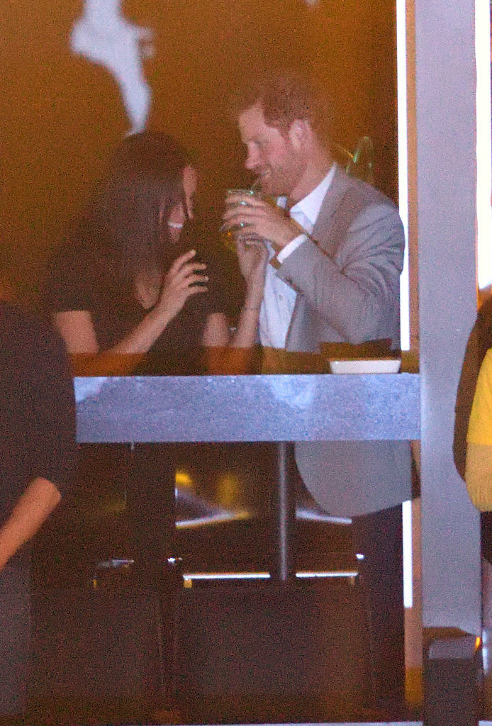 Prince Harry and Meghan Markle snuggle and kiss at the Invictus Games closing ceremony
