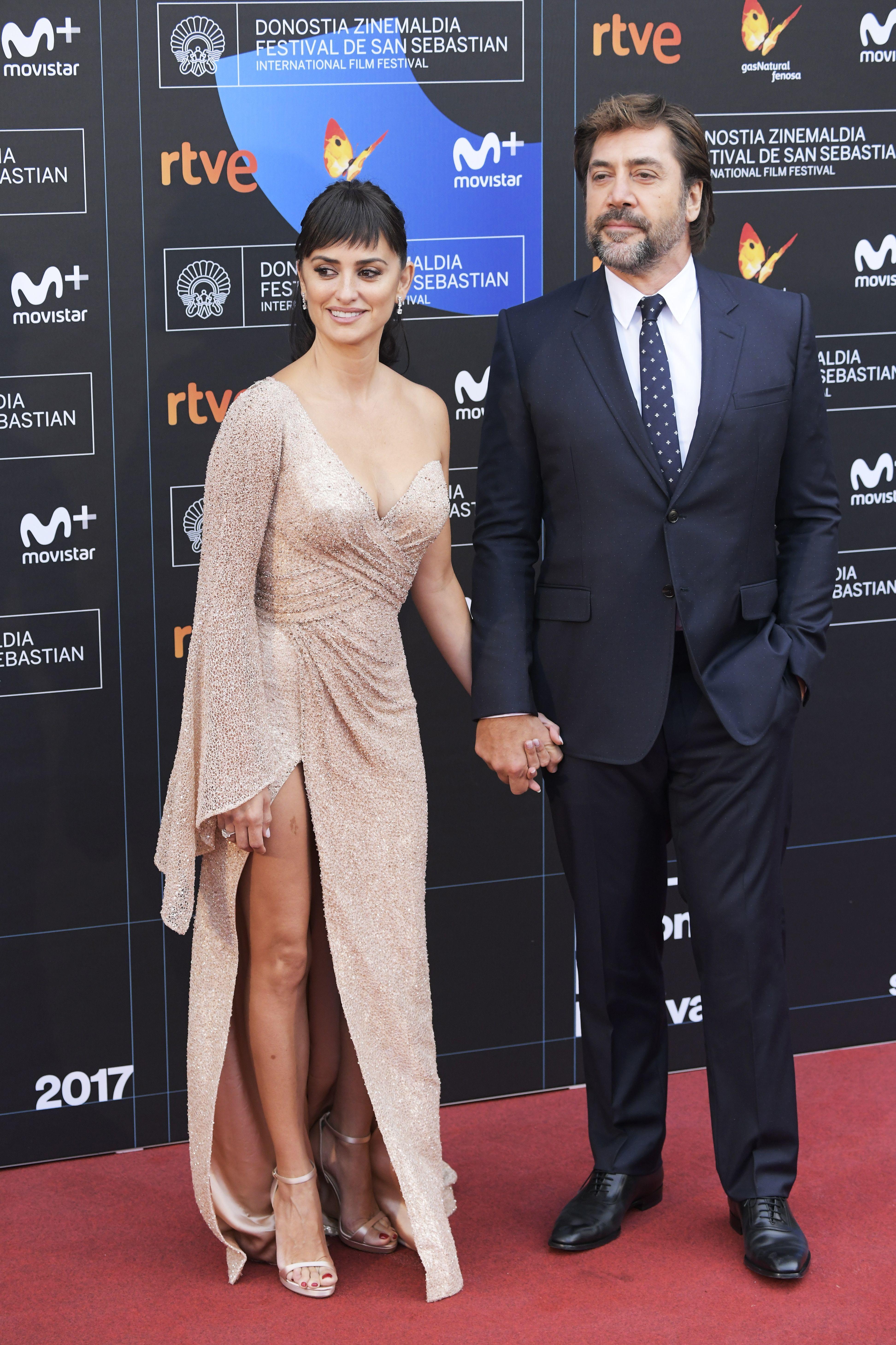 "Penelope Cruz and Javier Bardem hold hands during the 65th San Sebastian Film Festival premiere of ""Loving Pablo"" in Spain on Sept. 30, 2017."
