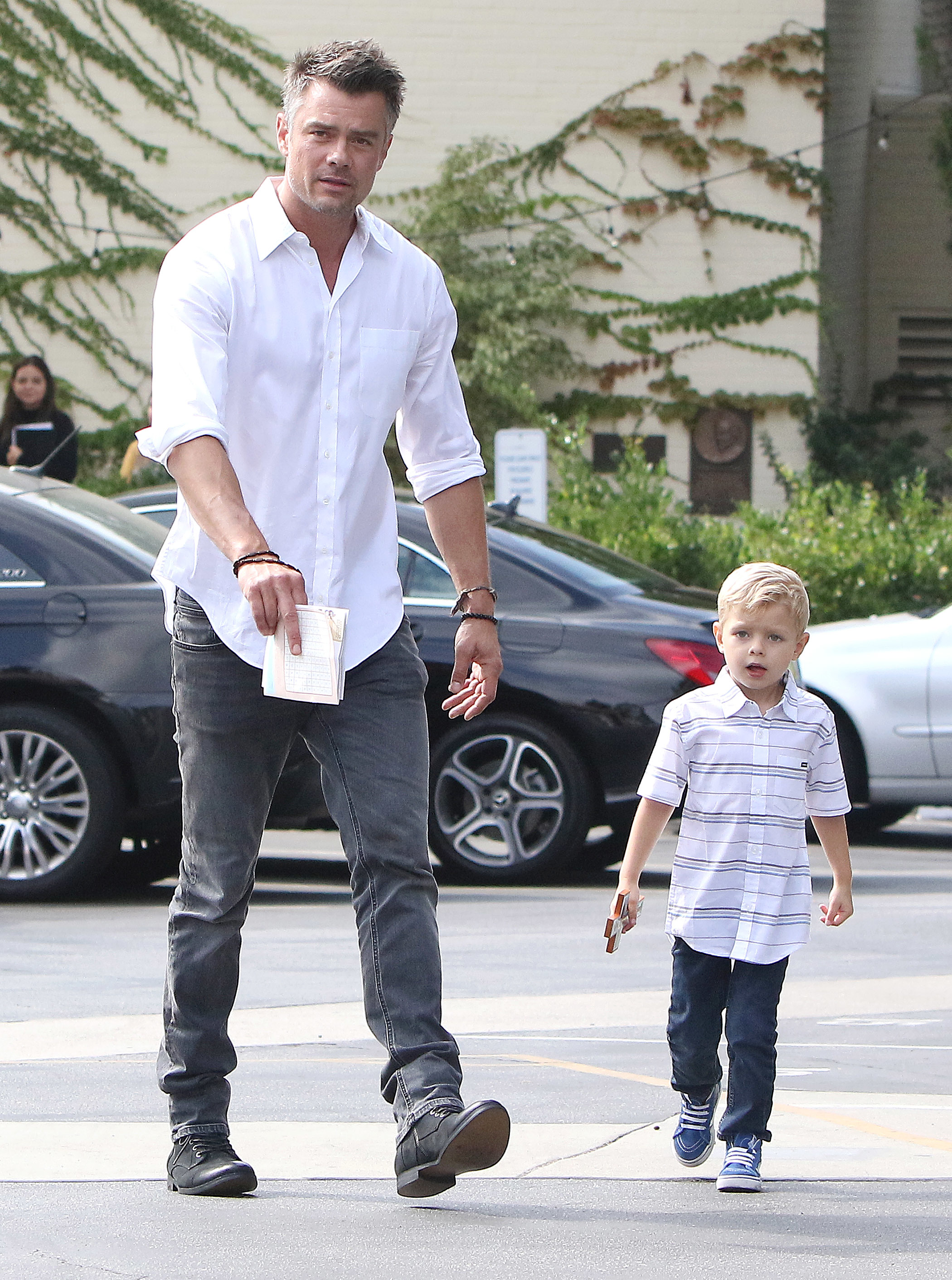 Josh Duhamel and his son, Axl, attend church services in Los Angeles on Oct. 1, 2017.