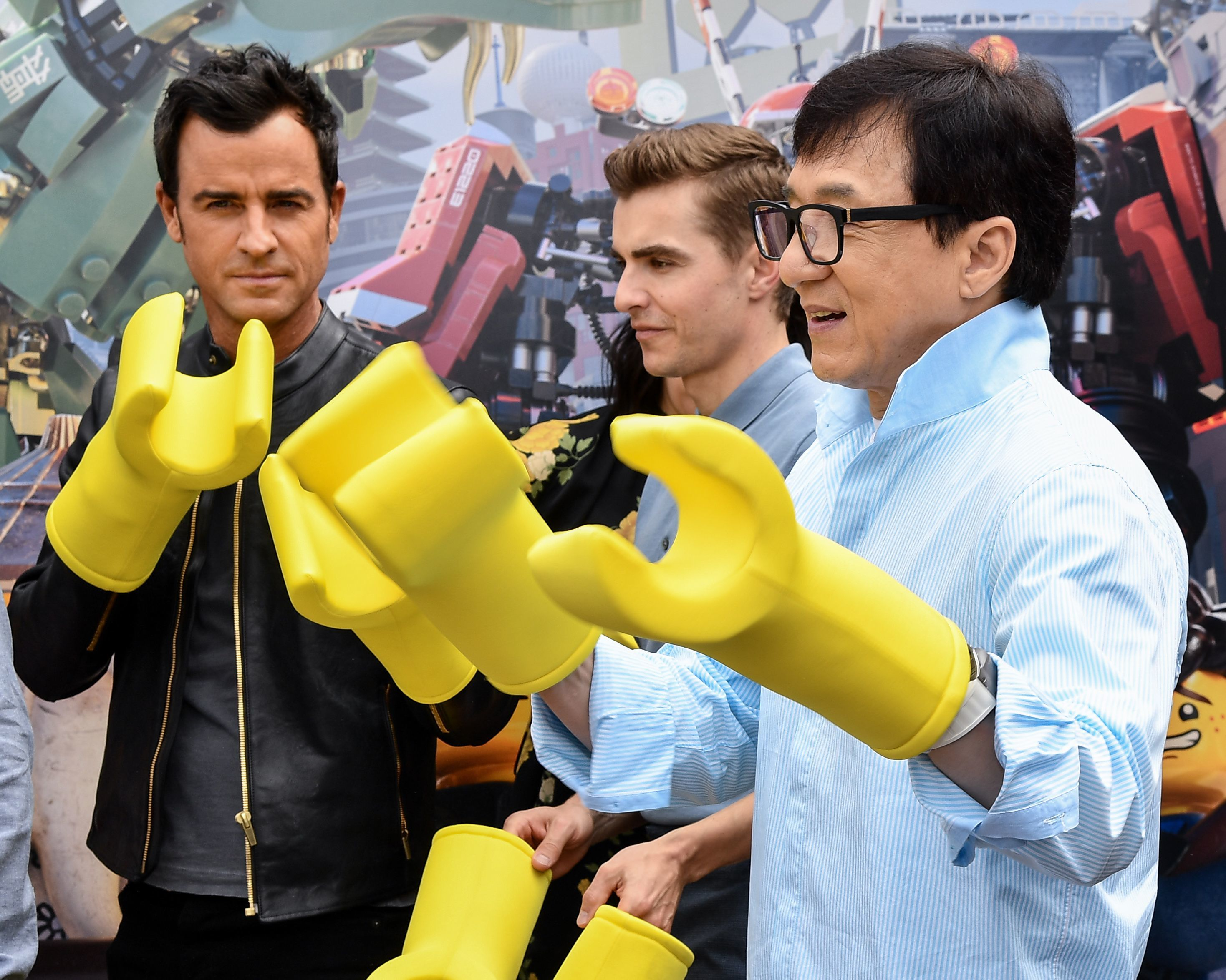 """Justin Theroux, Dave Franco and Jackie Chan attend the """"Ninjago"""" film photocall at Legoland in Carlsbad, Calif., on Sept. 14, 2017."""