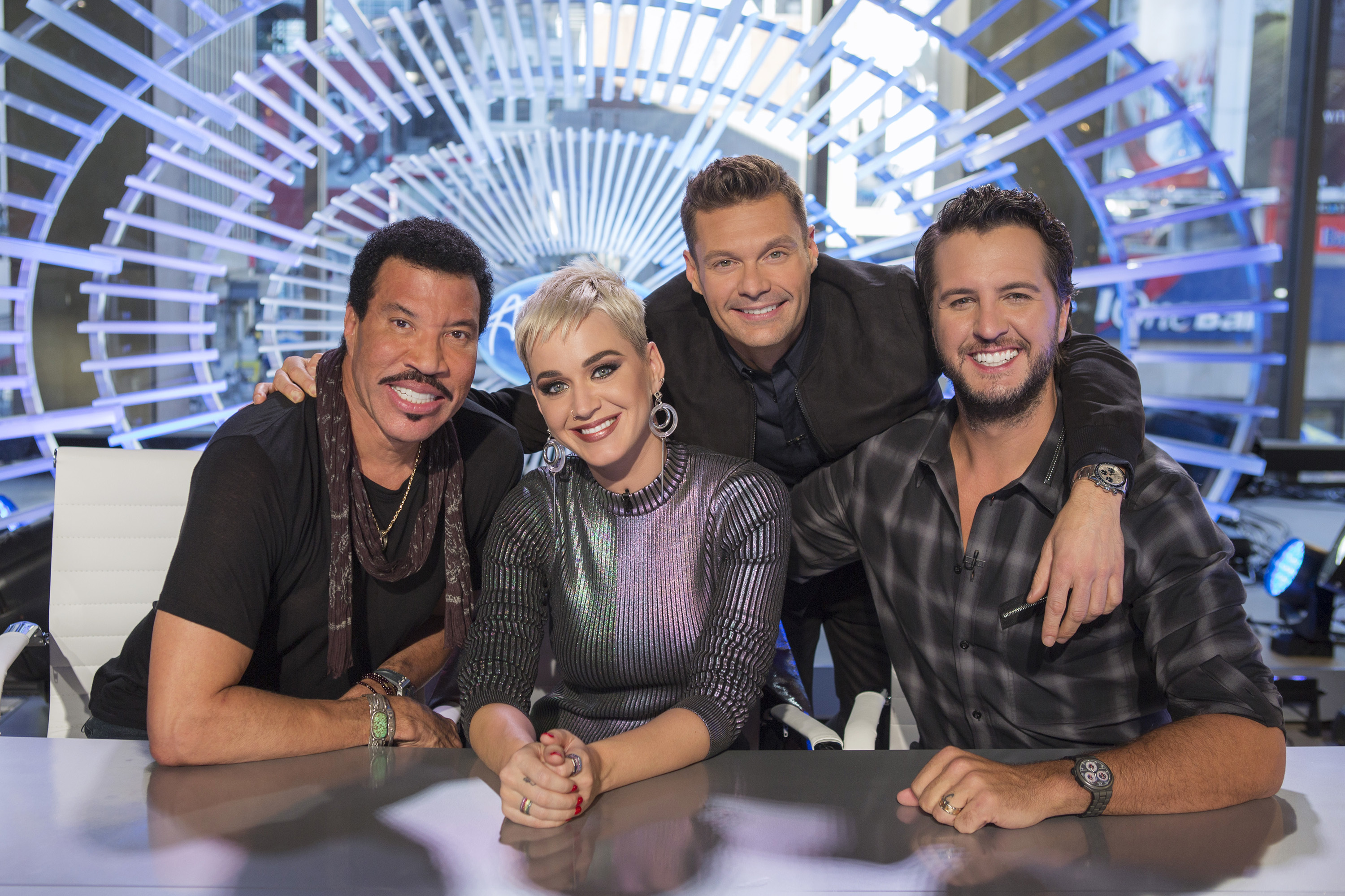 """ABC's """"American Idol"""" judges Lionel Richie, Katy Perry and Luke Bryan pose with host Ryan Seacrest for a photo released by ABC on Oct. 4, 2017."""