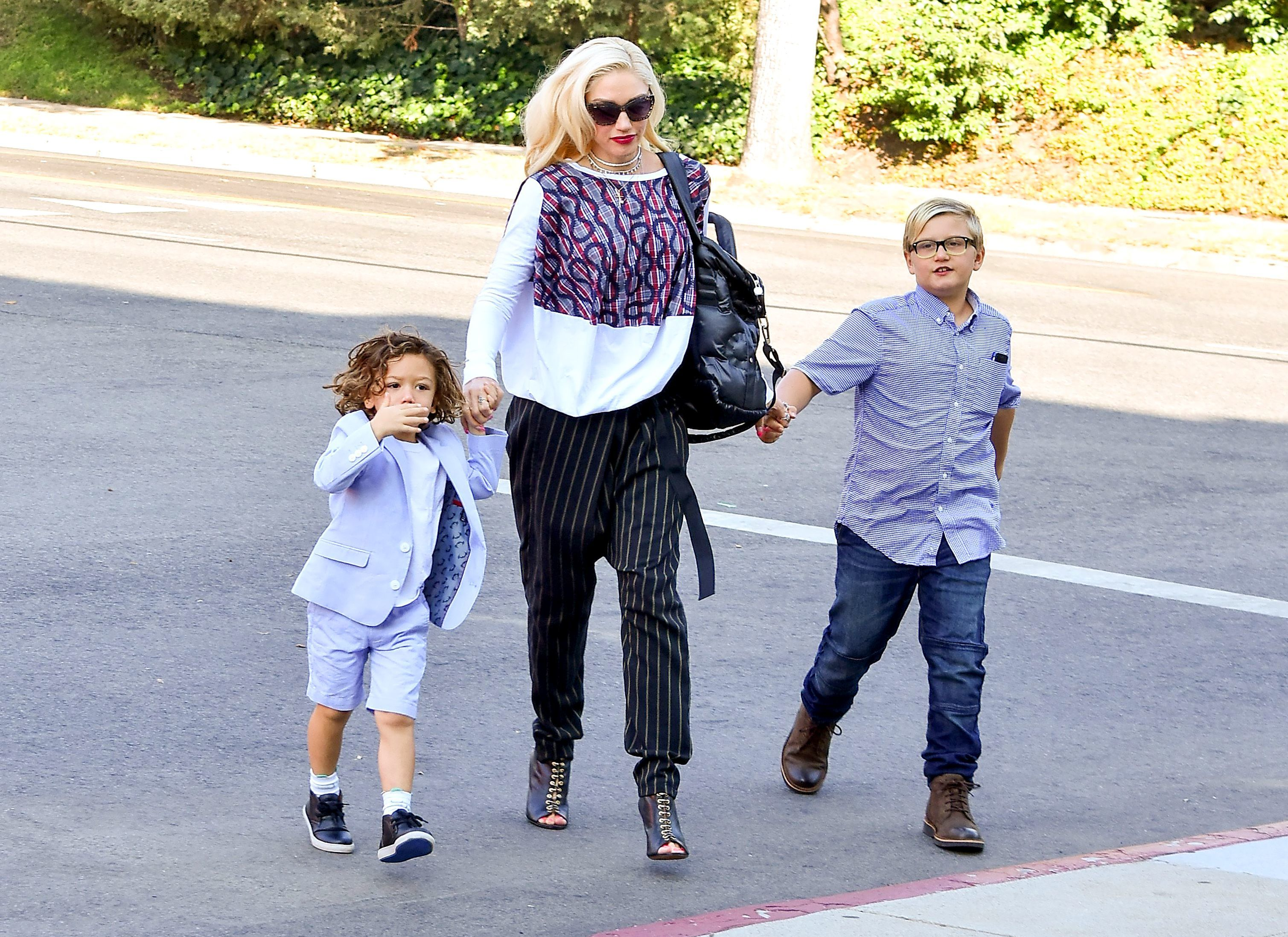 Gwen Stefani takes two of her sons, Apollo Rossdale and Zuma Rossdale, to church in Los Angeles on Oct. 8, 2017.