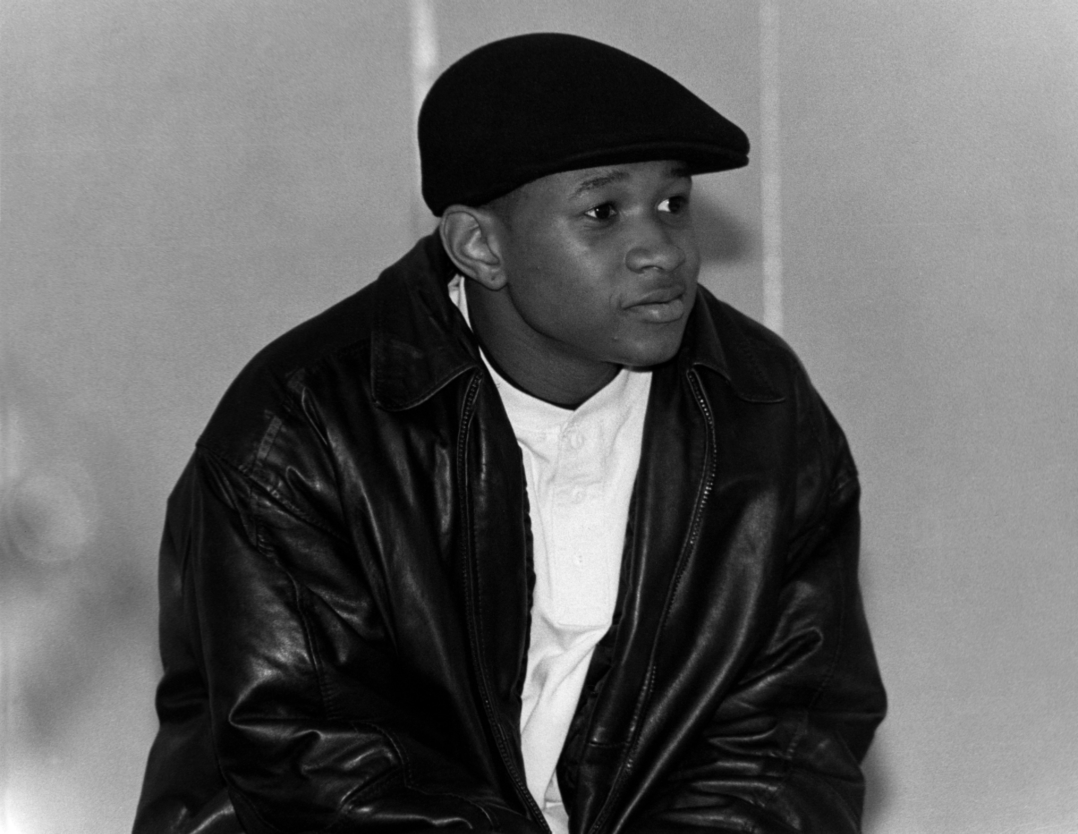 Singer Usher talks to students at Chicago Vocational High School in December 1994.