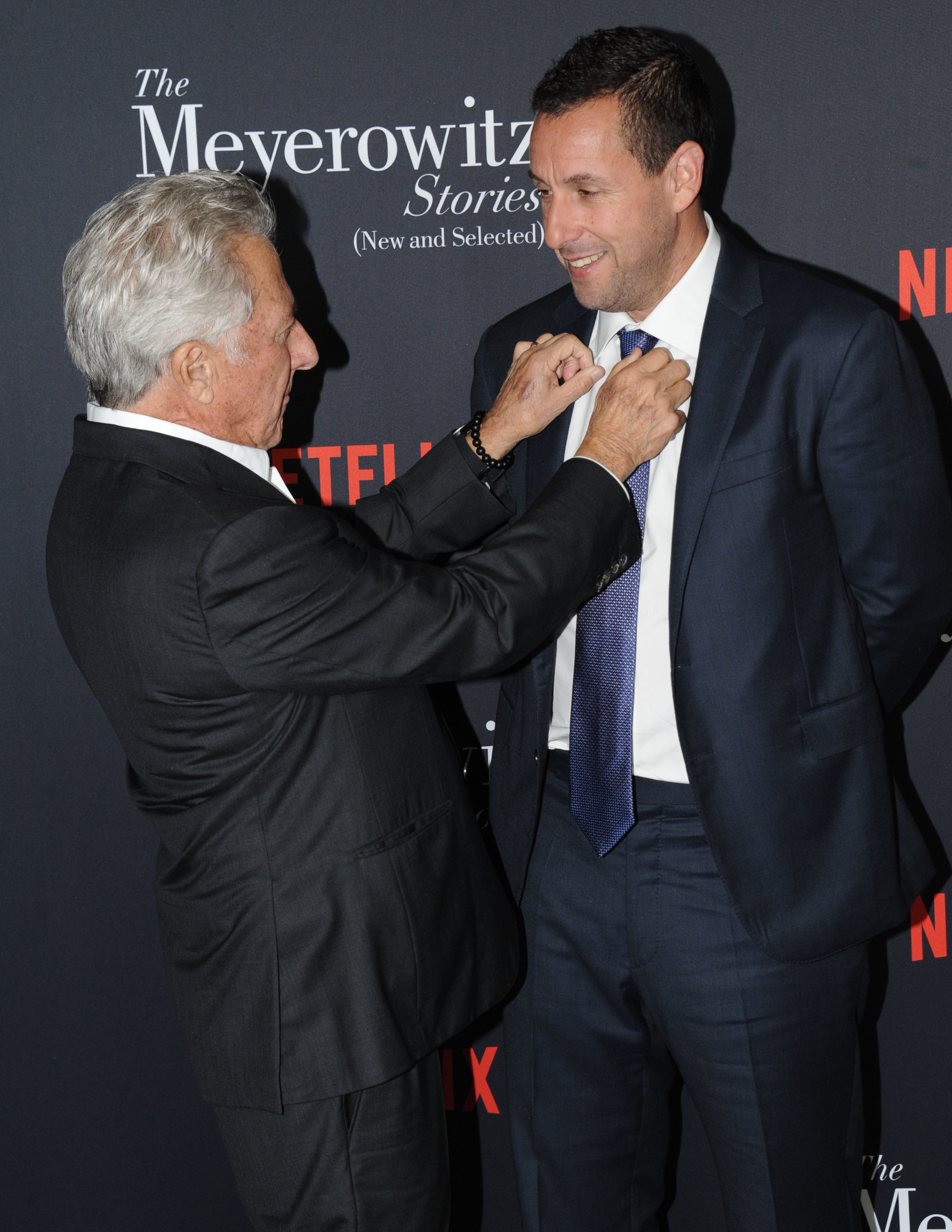 "Dustin Hoffman helped his buddy Adam Sandler fix his tie as they arrived at a screen of Netflix's ""The Meyerowitz Stories"" in Los Angeles on Oct. 11, 2017."