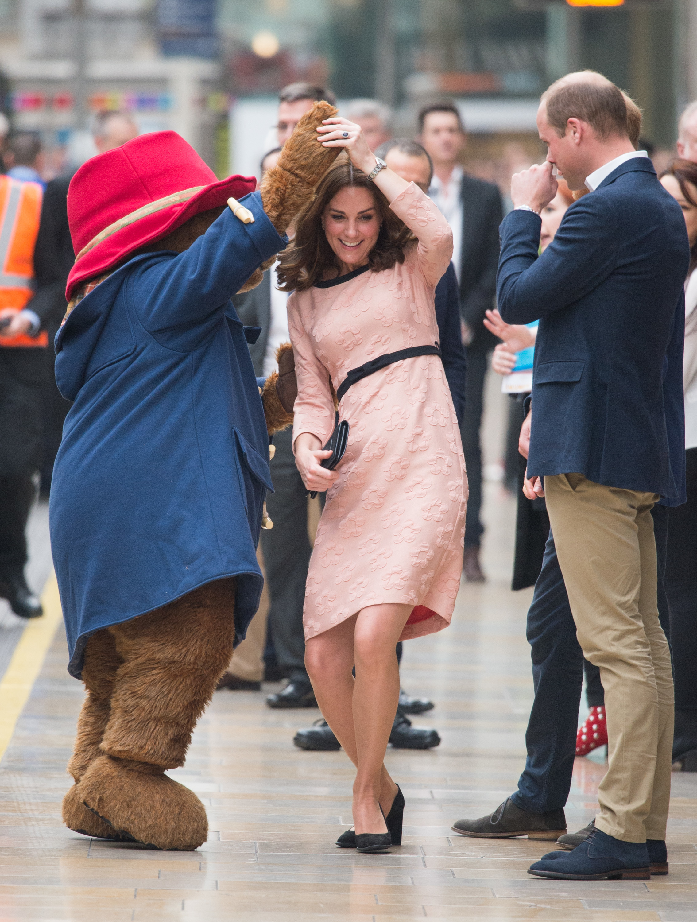 Duchess Kate and Prince William attend and event with Paddington Bear at London's Paddington Station on Oct. 13, 2017.