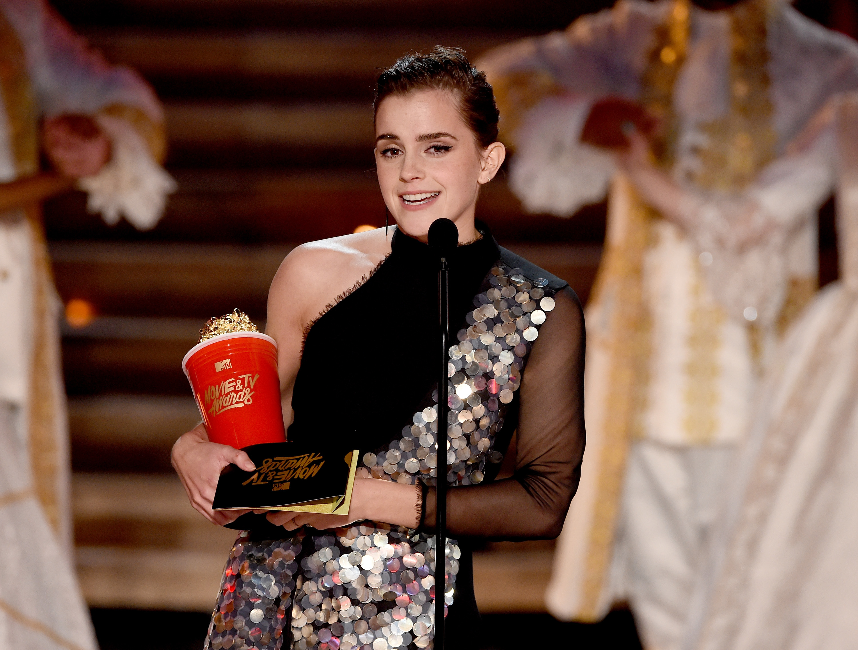 Emma Watson accepts the award for Best Actor in a Movie onstage during the 2017 MTV Movie And TV Awards at The Shrine Auditorium on May 7, 2017.