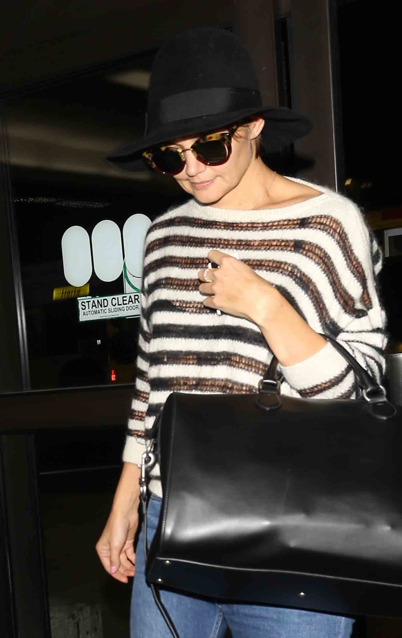 Katie Holmes arrives at LAX on Oct. 19, 2017.