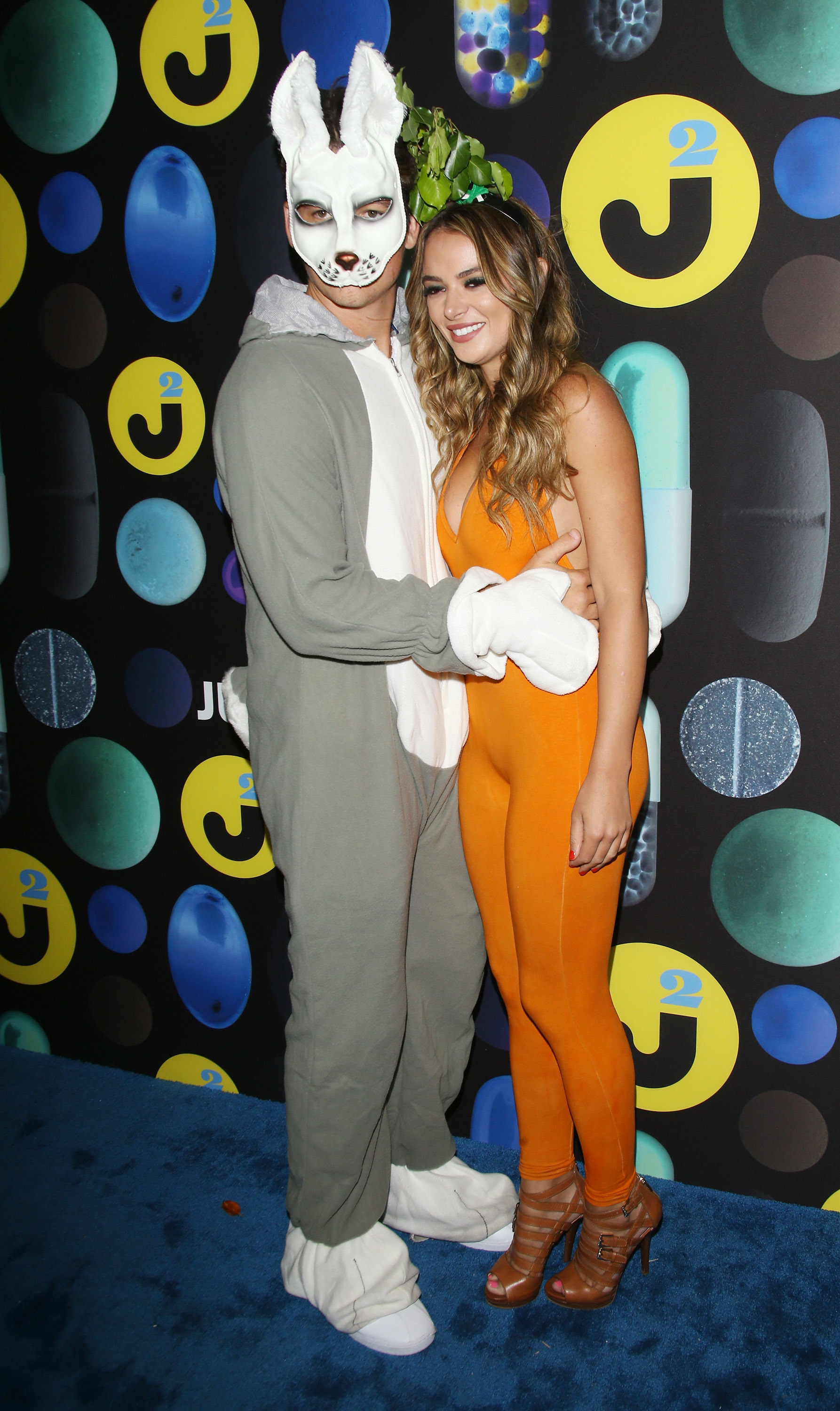 Miles Teller dressed as a rabbit while Keleigh Sperry donned a carrot costume at the  Just Jared Halloween Party held at No Vacancy in Los Angeles on Oct. 31, 2015.