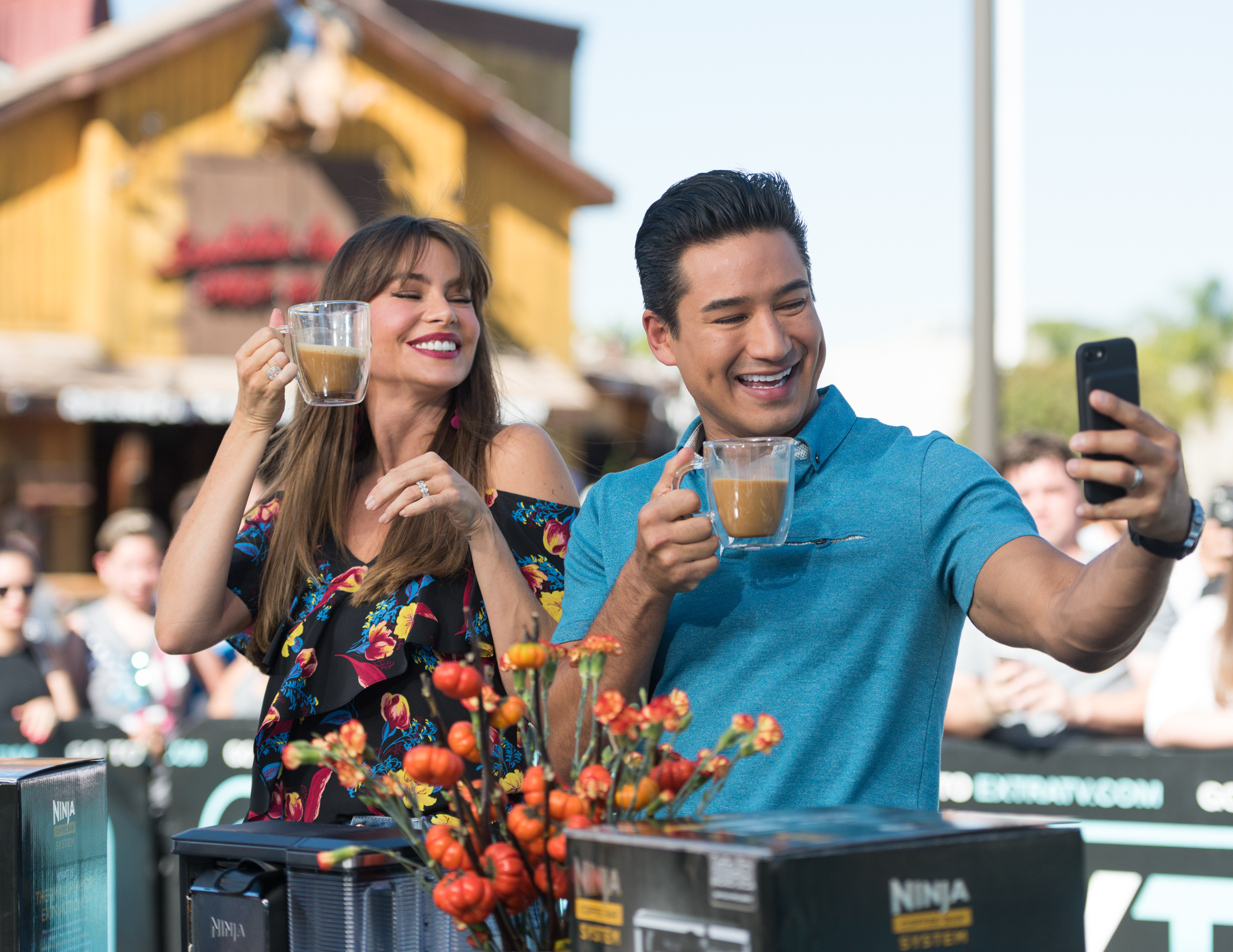 """Sofia Vergara and Mario Lopez drink coffee together at """"Extra"""" at Universal Studios Hollywood  in Universal City, Calif., on Oct. 23, 2017."""
