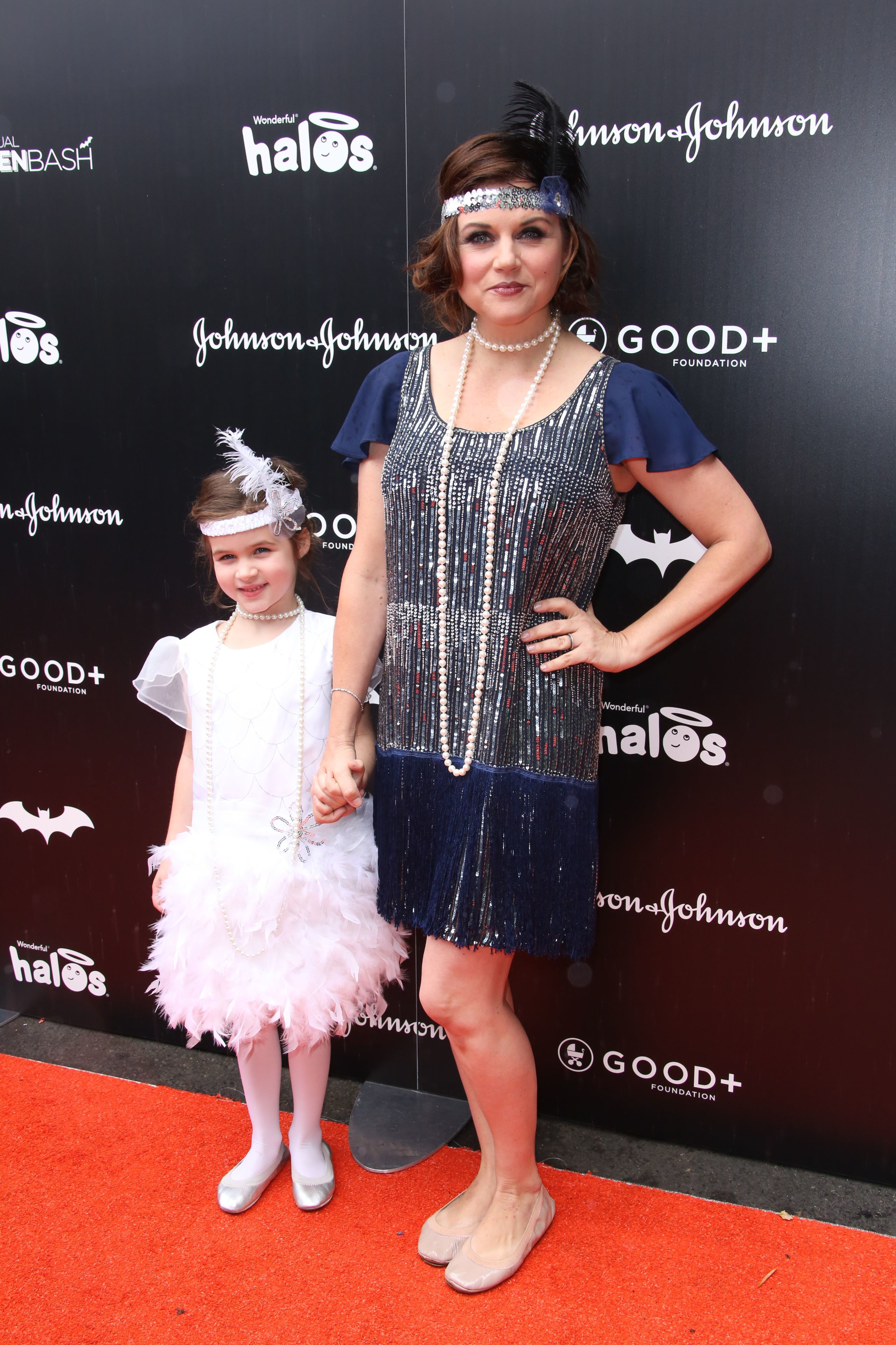 Tiffani Thiessen and her daughter, Harper Smith, attend the GOOD+ Foundation Halloween Bash in Los Angeles on Oct. 30, 2016.