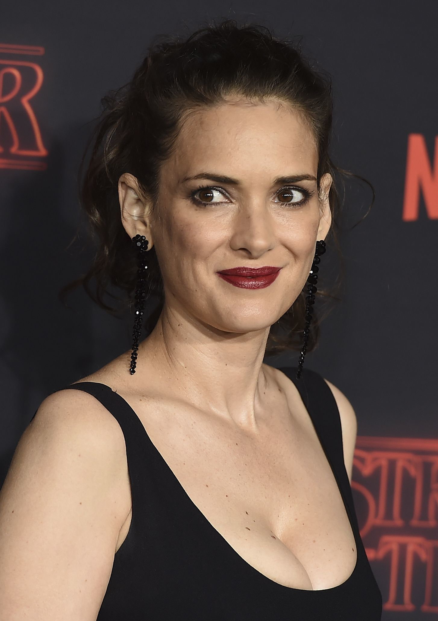 """Winona Ryder arrives at the premiere of """"Stranger Things"""" Season two at the Regency Bruin Theater in Los Angeles on Oct. 26, 2017."""