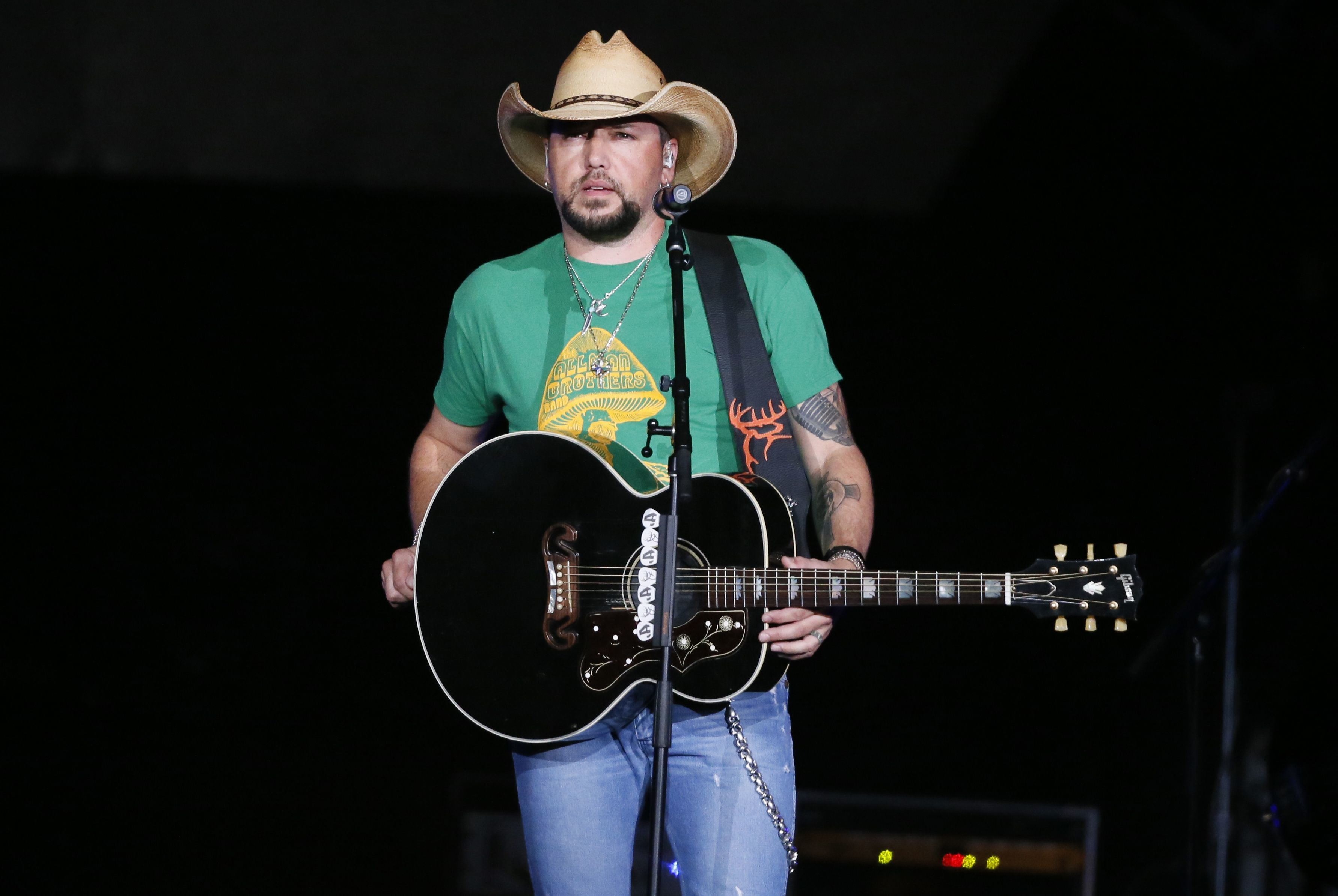 Jason Aldean addresses the crowd about the shooting in Las Vegas during his concert in Tulsa, Okla., on Oct. 12, 2017.