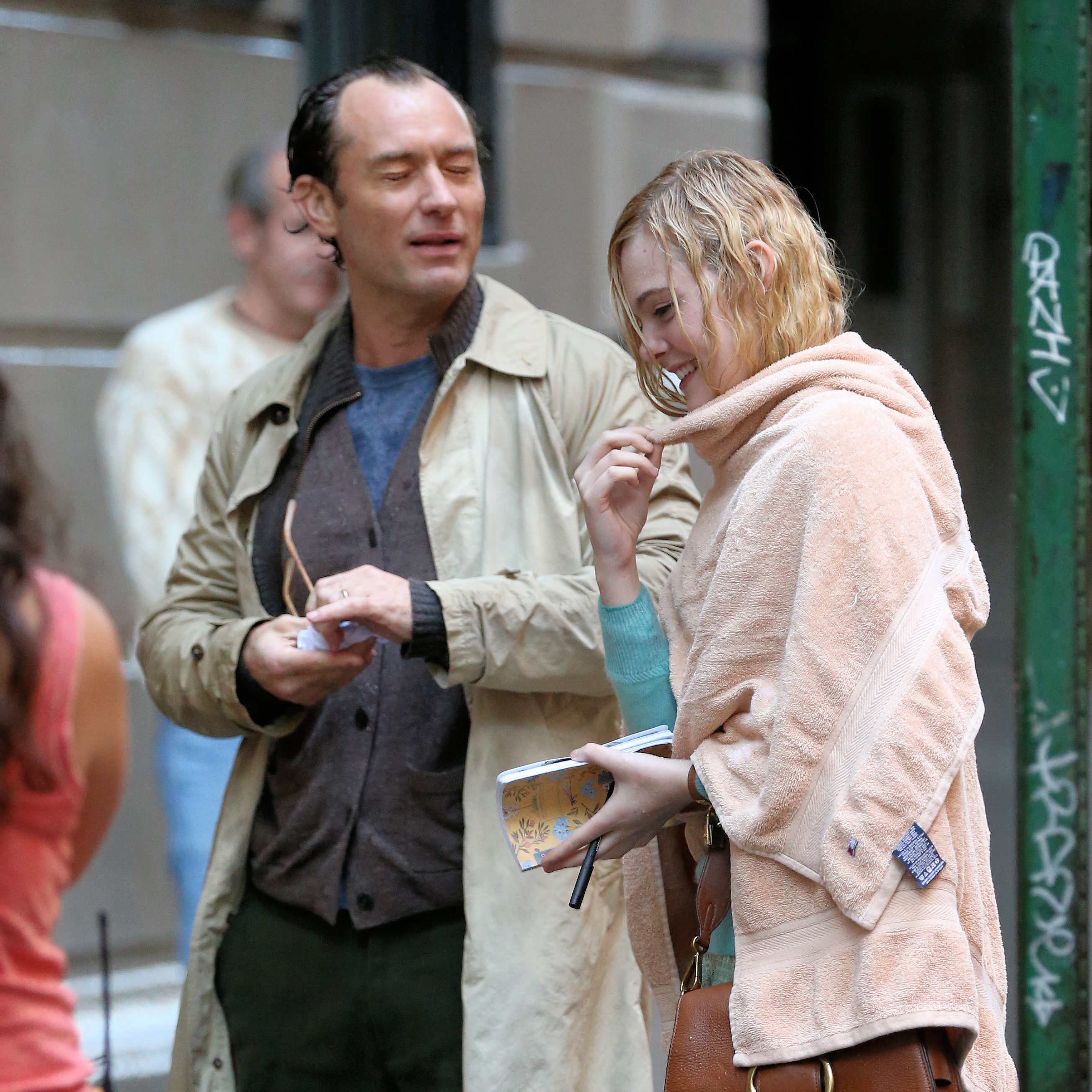 Jude Law and Elle Fanning on the set in New York City on Oct. 18, 2017.