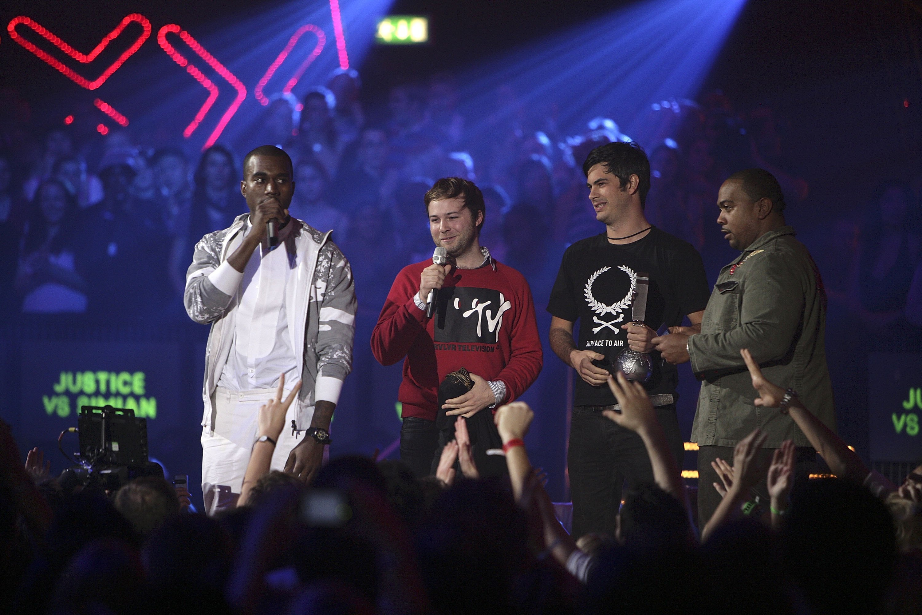"""Kanye West (L) and Timbaland present the Best Video Award to Jeremie Rozan and Martial Schmeltz, directors of """"We Are Your Friends"""" by Justice Vs Simian on stage at the 13th annual MTV Europe Music Awards at the Bella Center in Copenhagen, Denmark on November 2, 2006."""