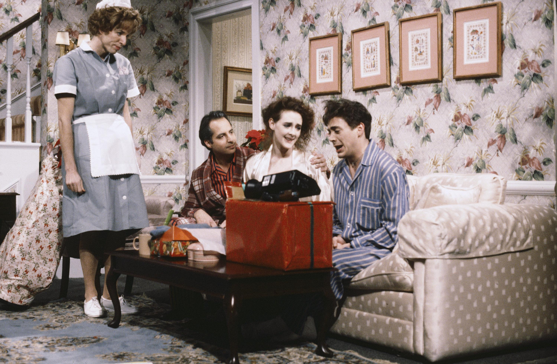 "Terry Sweeney as Hildy, Jon Lovitz as Mr. Deaver, Joan Cusack as Mrs. Deaver and Robert Downey Jr. as Skip Deaver during ""Hildy"" sketch on ""SNL"" on Dec. 21, 1985."
