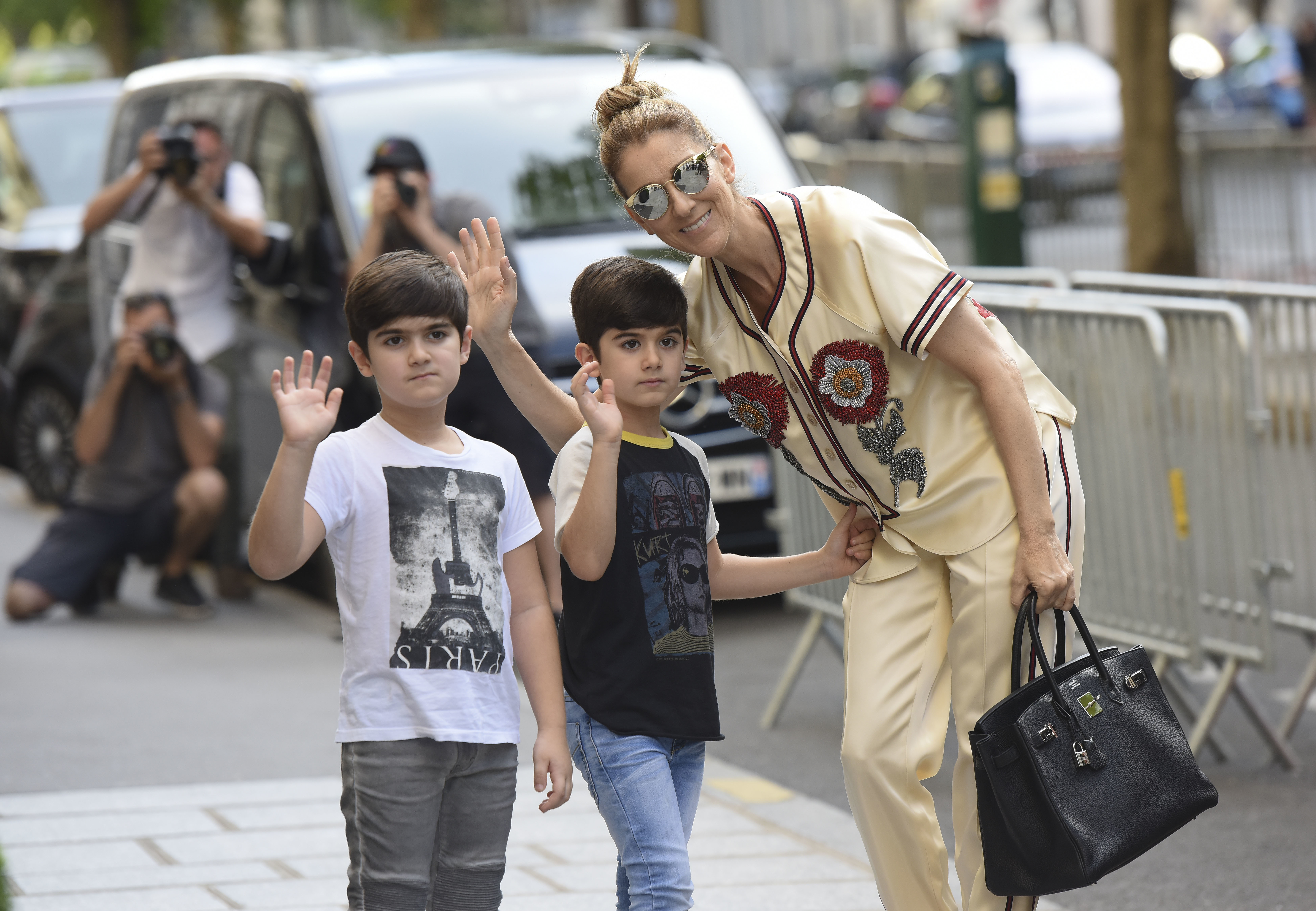 Celine Dion and her twins spotted visiting the optician before returning to the Royal Monceau's hotel in Paris on July 17, 2017.