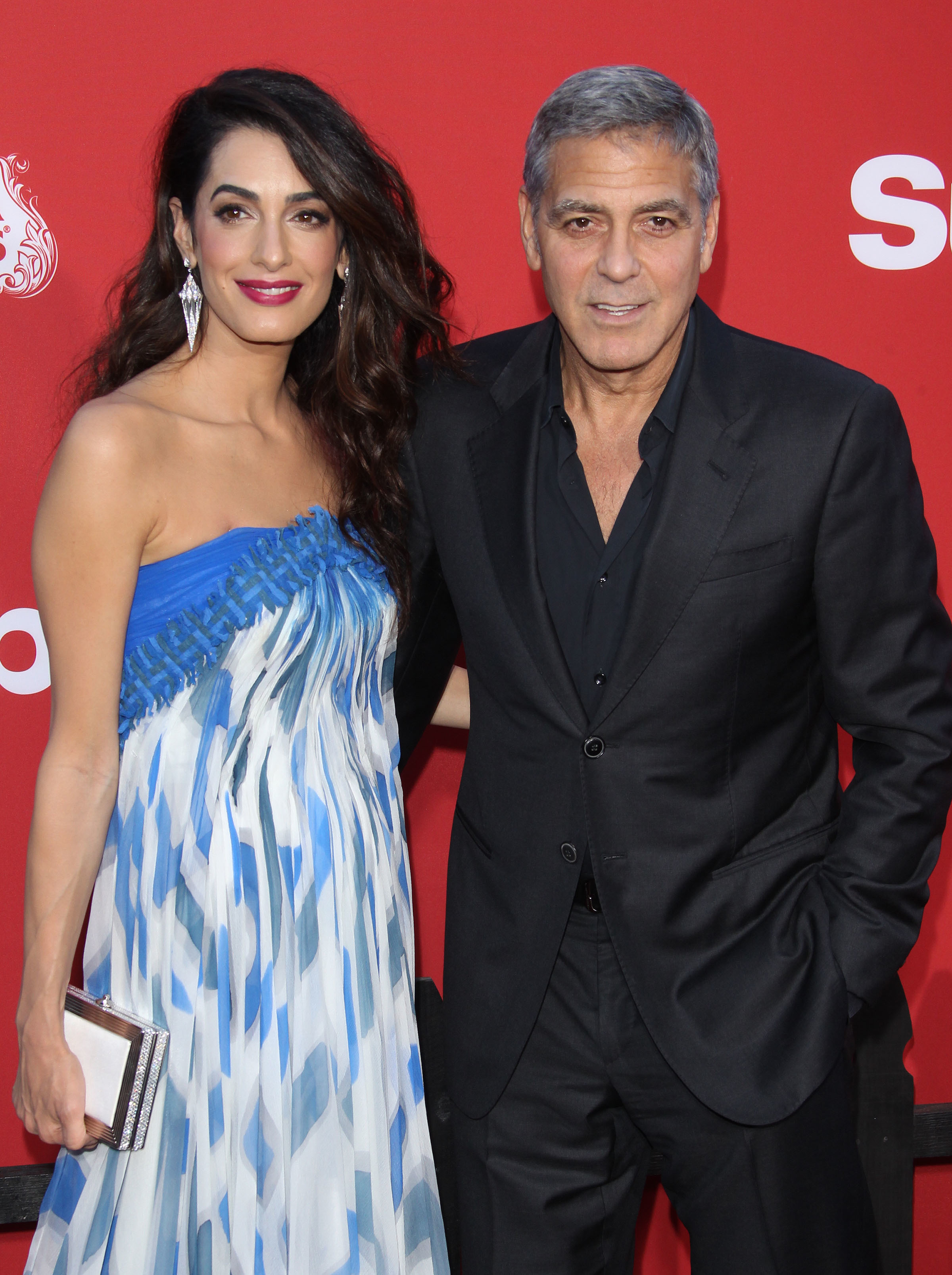 Amal Clooney and George Clooney attend the Suburbicon film premiere in Los Angeles on Oct. 22, 2017.