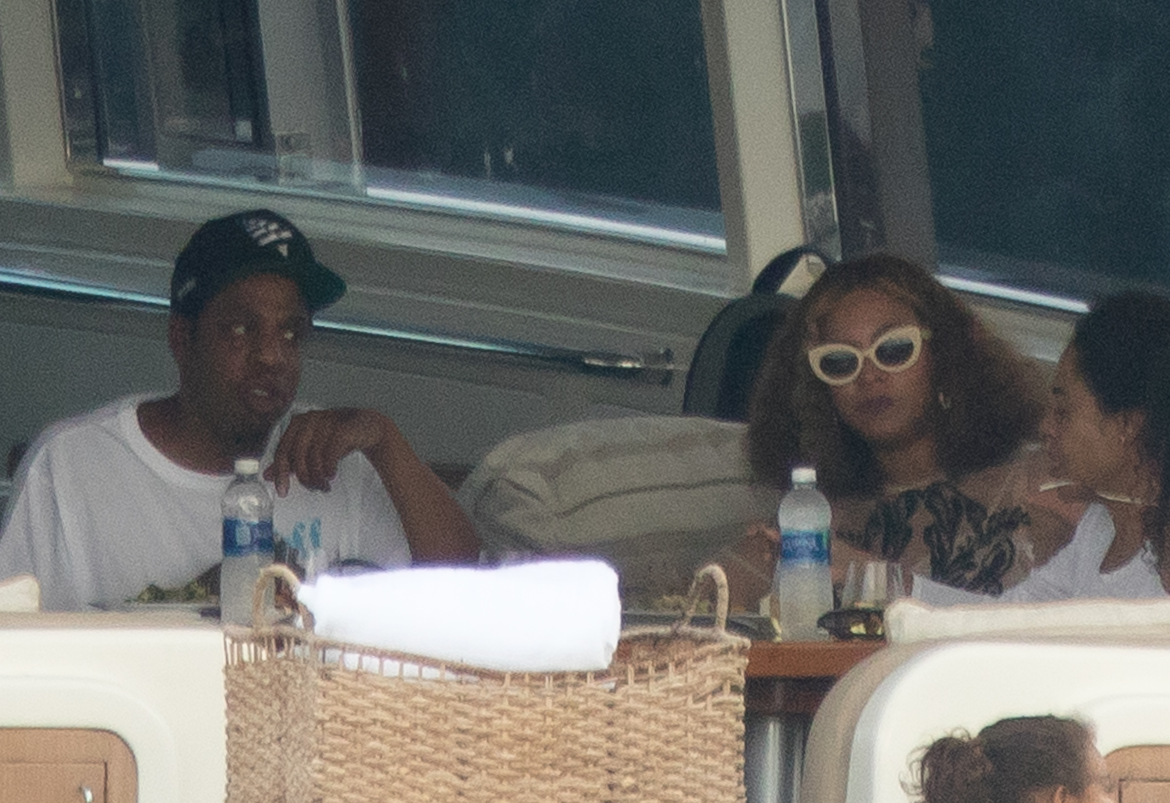 Jay Z and Beyonce have lunch on a boat cruise around Miami with daughter Blue Ivy on Nov. 13, 2017.