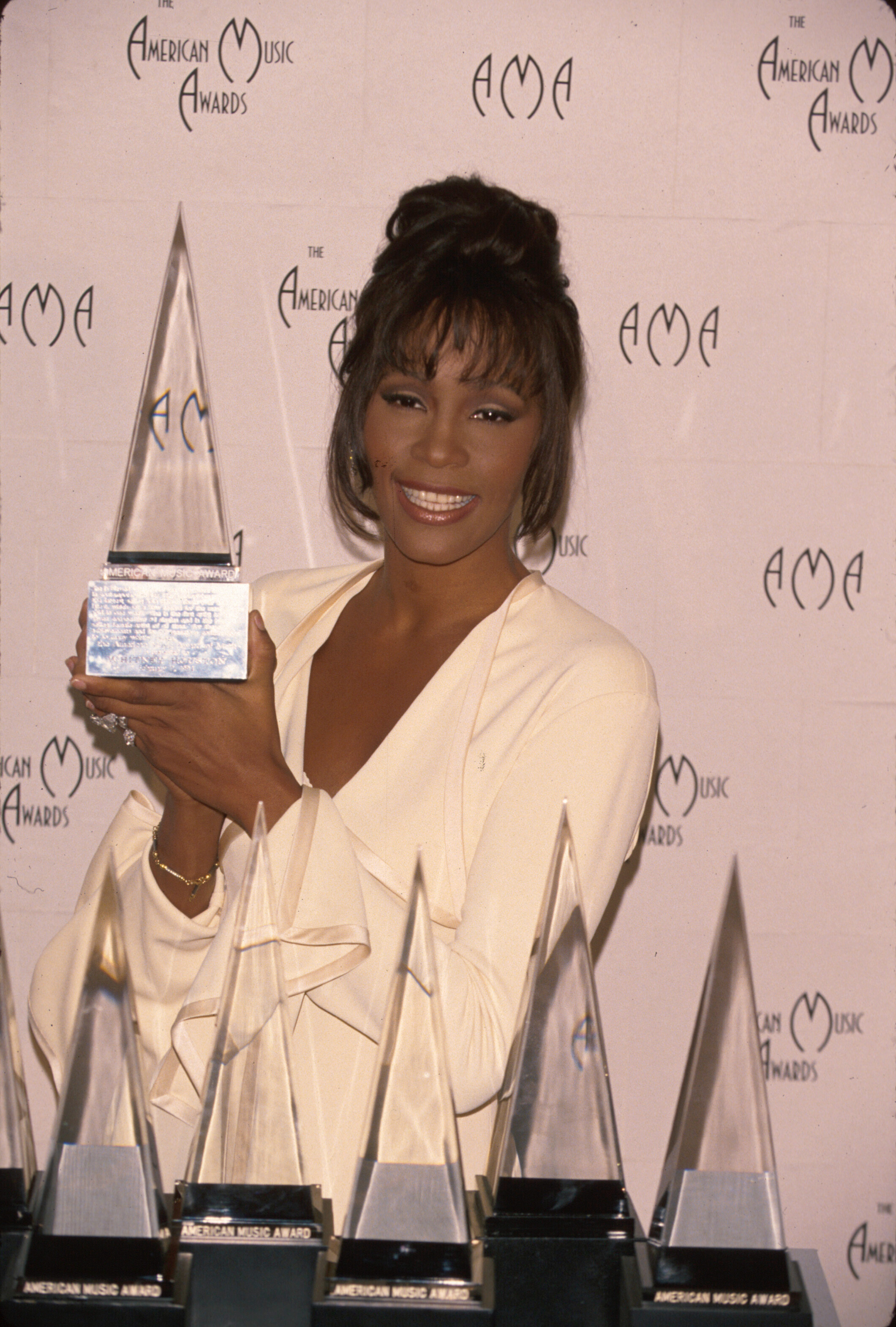 Whitney Houston holds her award in Press Room at American Music Awards held on Feb, 7, 1994.