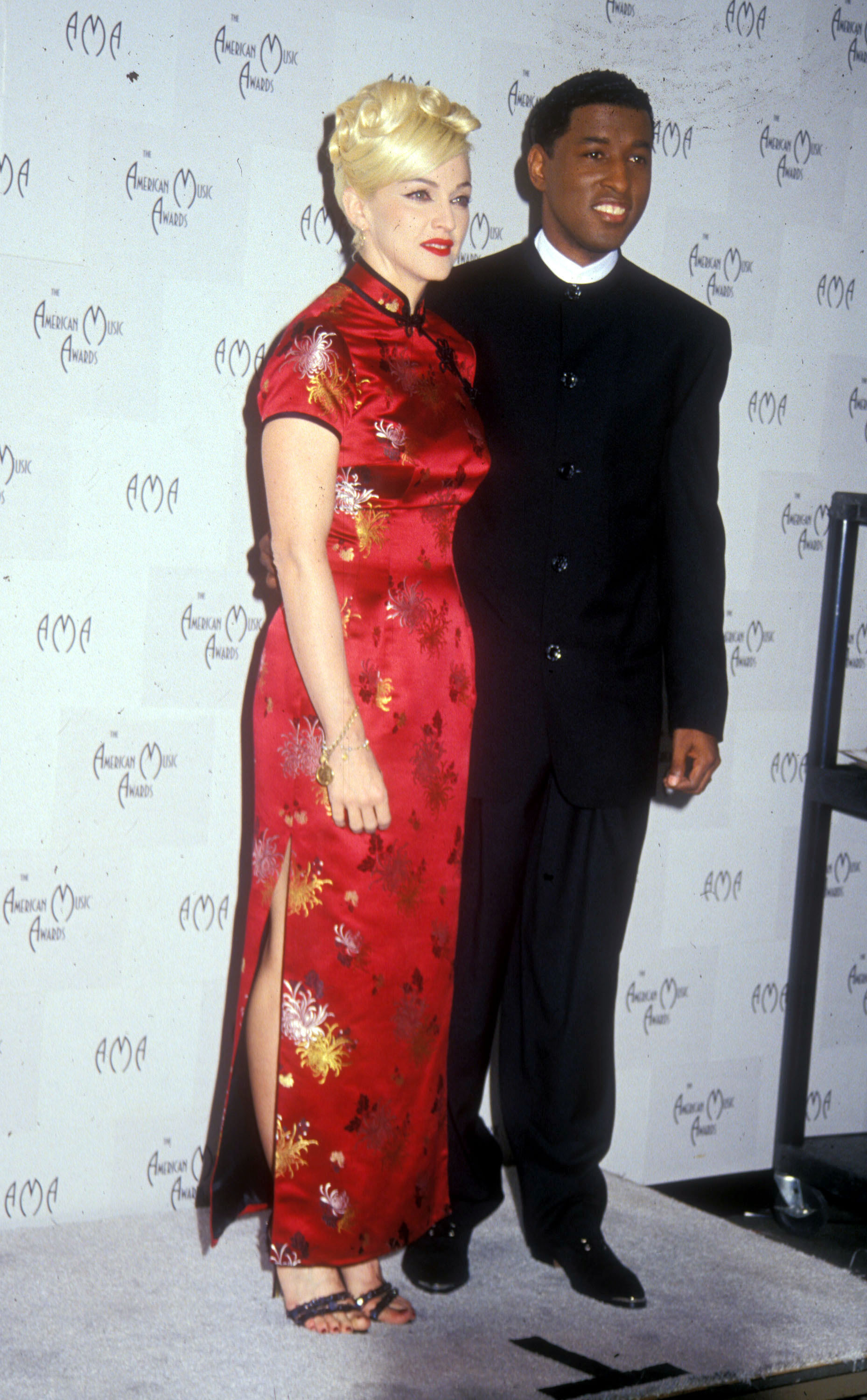 Madonna and Babyface Edmonds pose after performing together at the 22nd American Music Awards in Los Angeles on Jan. 30, 1995.
