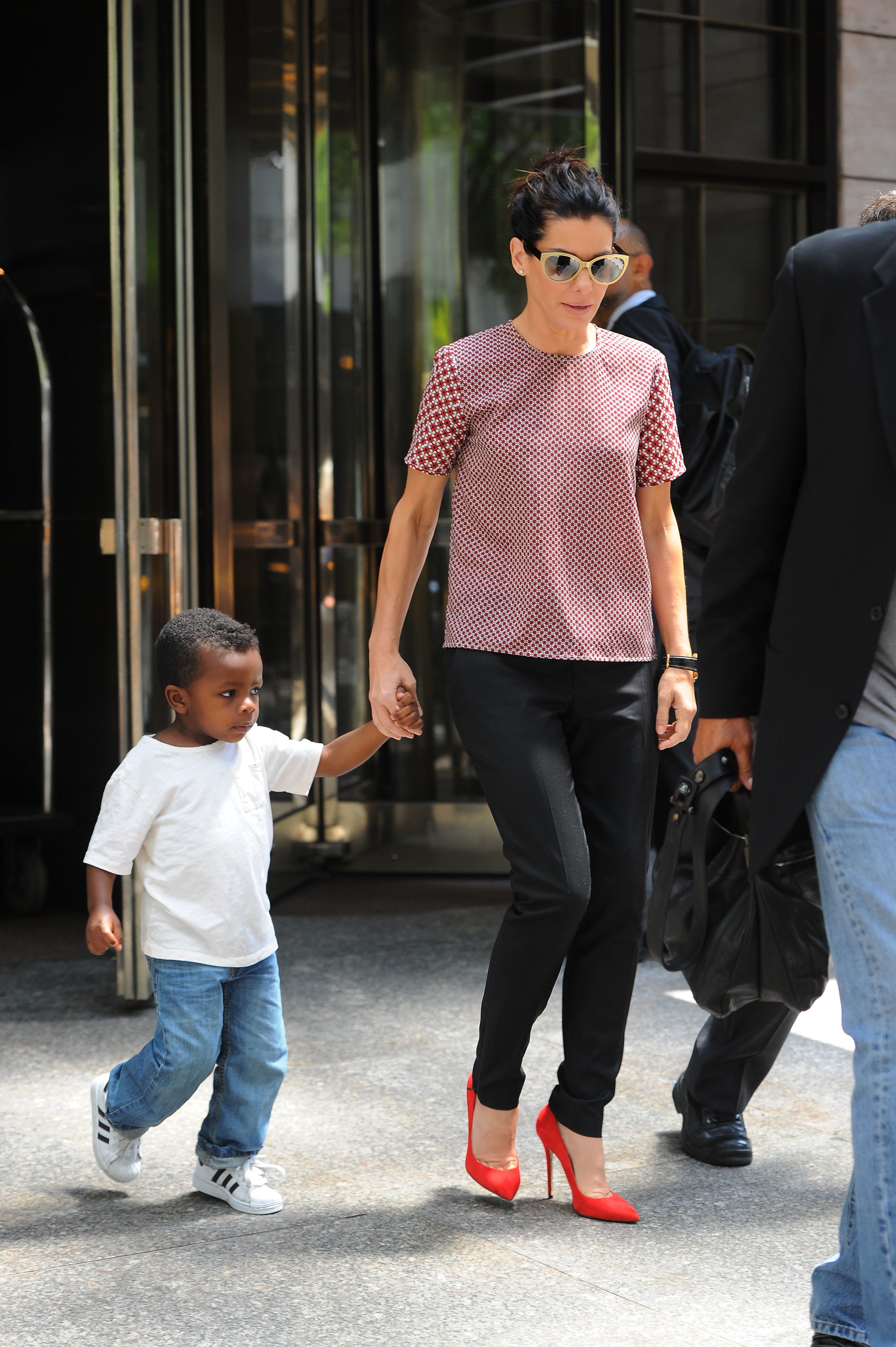 Sandra Bullock and son Louis seen out in New York City on June 24, 2013.