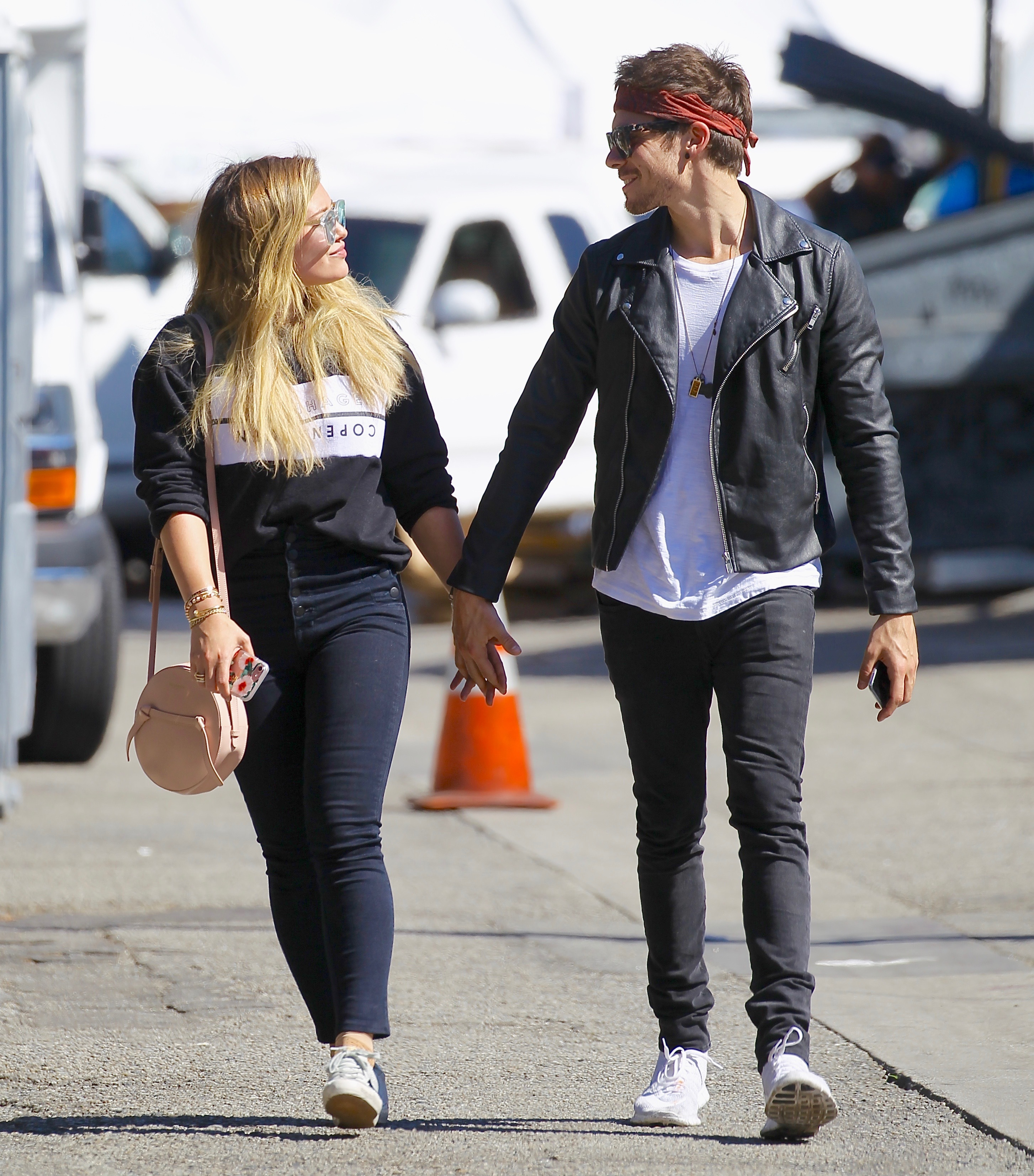 Hilary Duff held hands with on again boyfriend Matthew Koma at the Studio City Farmers Market on Nov. 12, 2017.