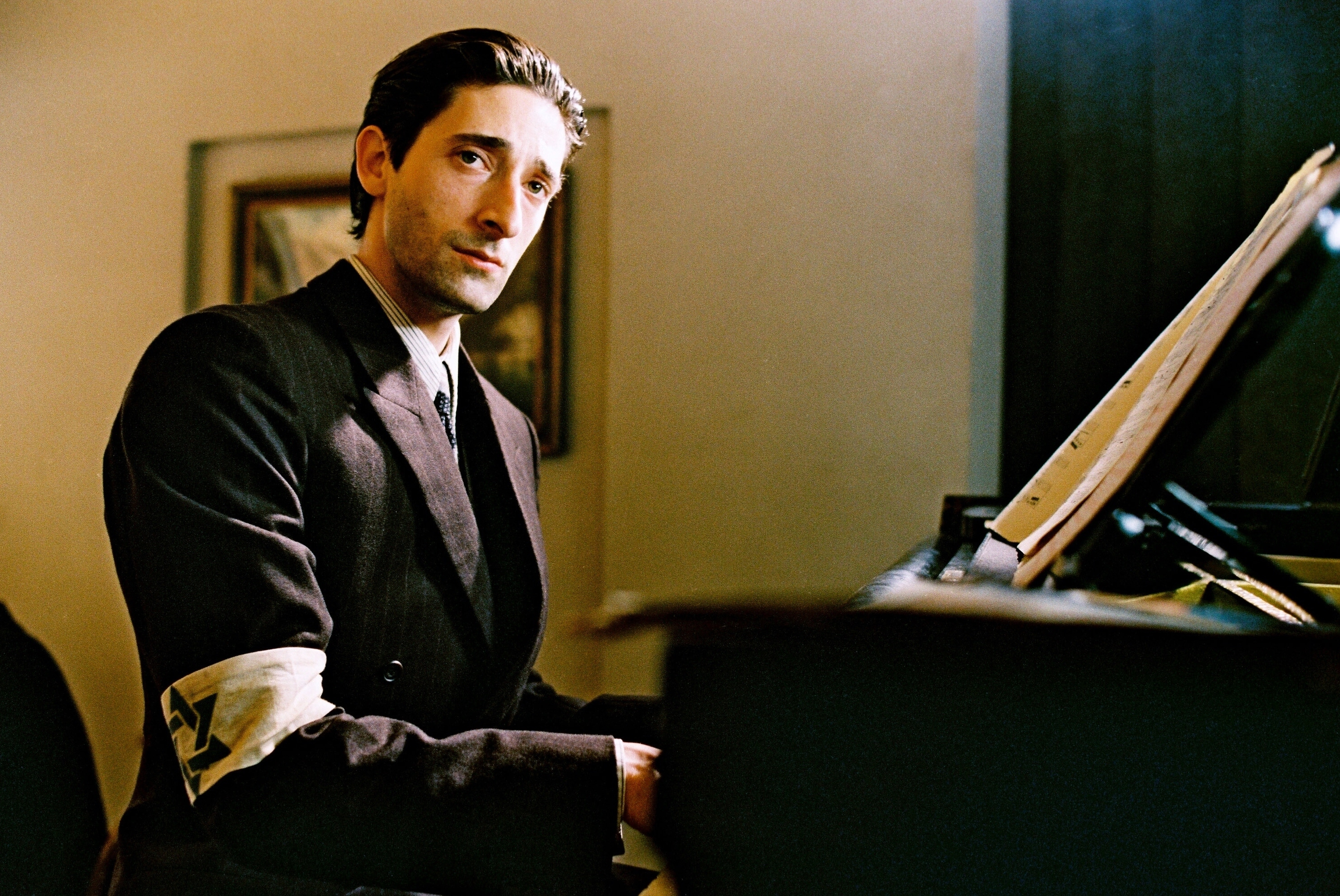 "Adrien Brody is pictured as Władysław Szpilman in the 2002 film ""The Pianist."""
