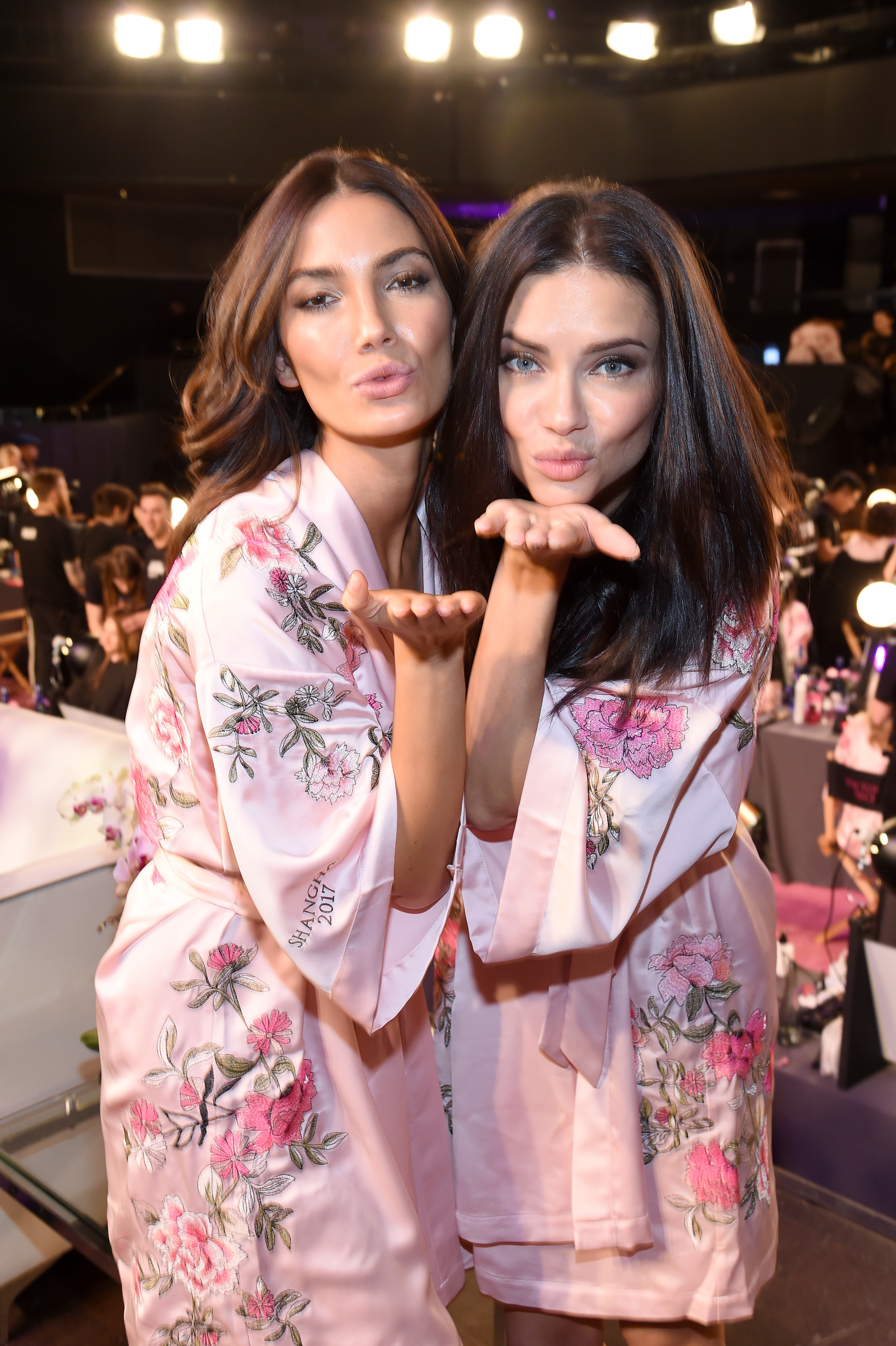 Lily Aldridge and Adriana Lima pose in Hair & Makeup during 2017 Victoria's Secret Fashion Show at Mercedes Benz Arena in Shanghai on Nov. 20, 2017.