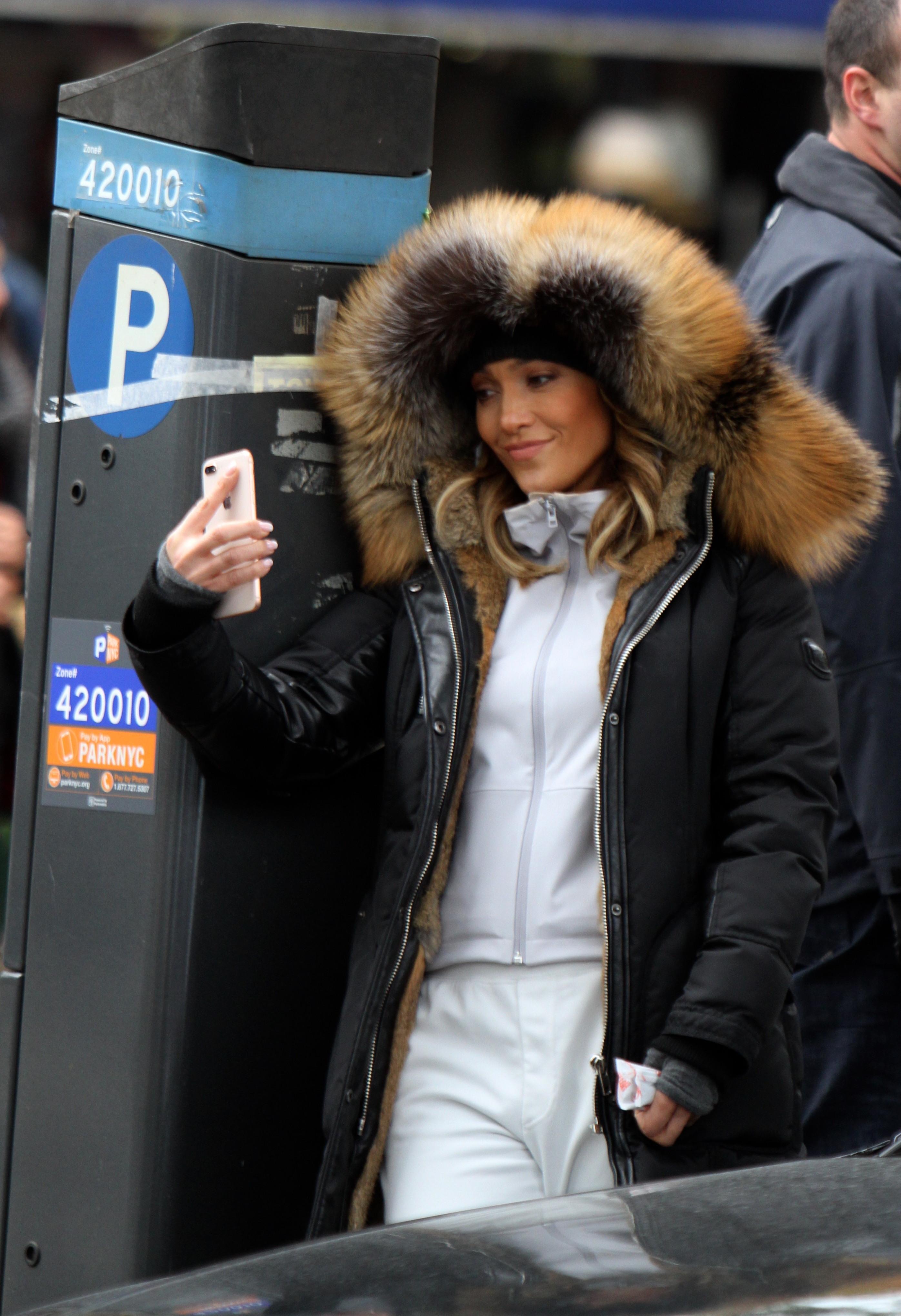 "Jennifer Lopez films a scene at the ""Second Act"" movie set in New York City on Nov. 7, 2017."
