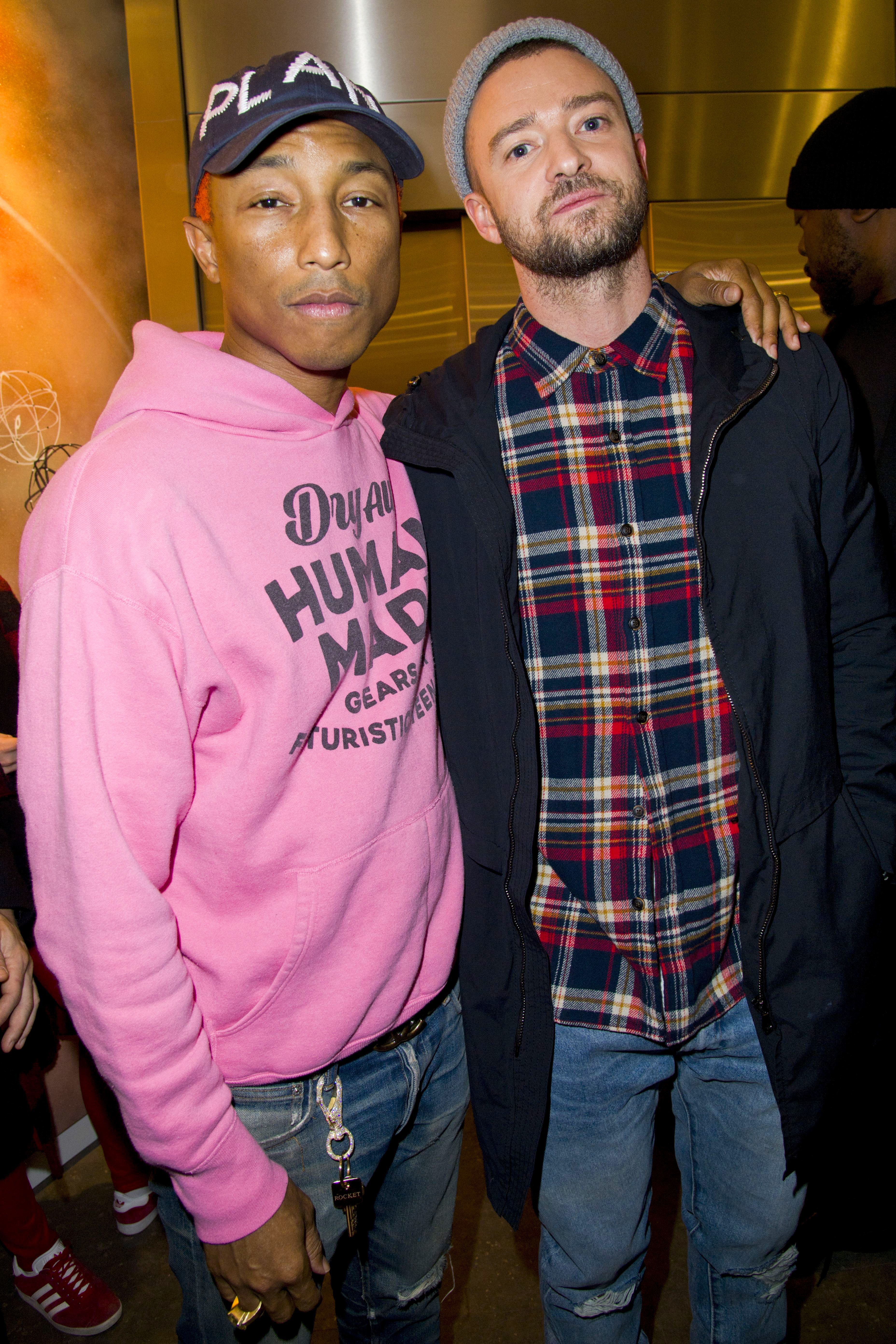 Pharrell Williams and Justin Timberlake attend the Chanel x Colette event in Paris on Nov. 21, 2017.