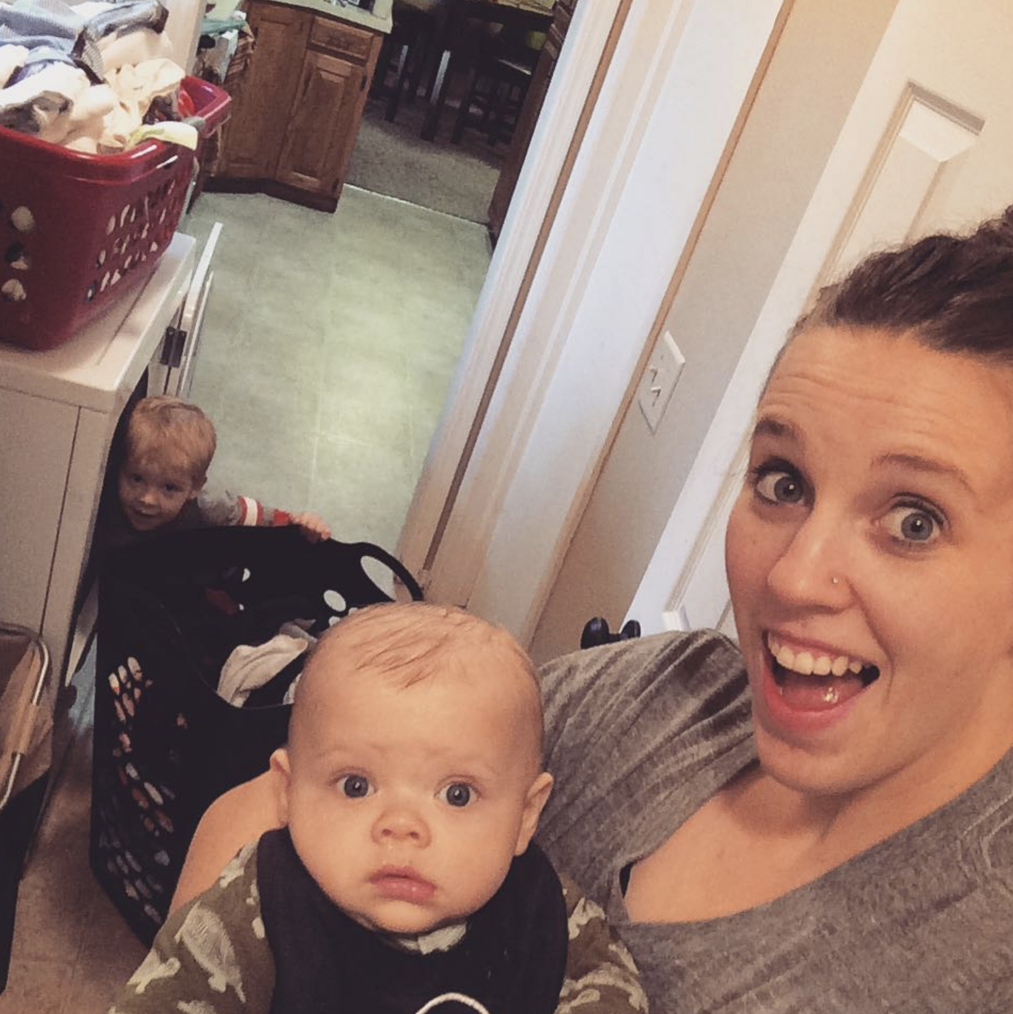 """""""When you are switching laundry from the washer to the dryer and realize you forgot to put laundry soap in the load you just 'washed'! 😋 #laundryday #boymom💙 #busymom""""   Jill Duggar Dillard, who posted this selfie with sons Israel and Samuel on Nov. 27, 2017"""