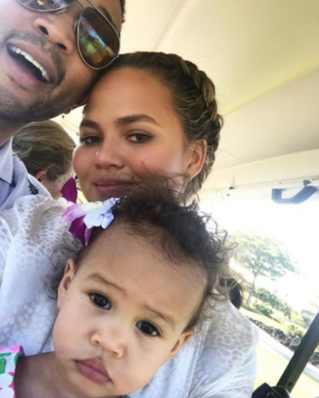Chrissy Teigen, John Legend and Luna Stephens appear in a photo Chrissy shared on Dec. 4, 2017.