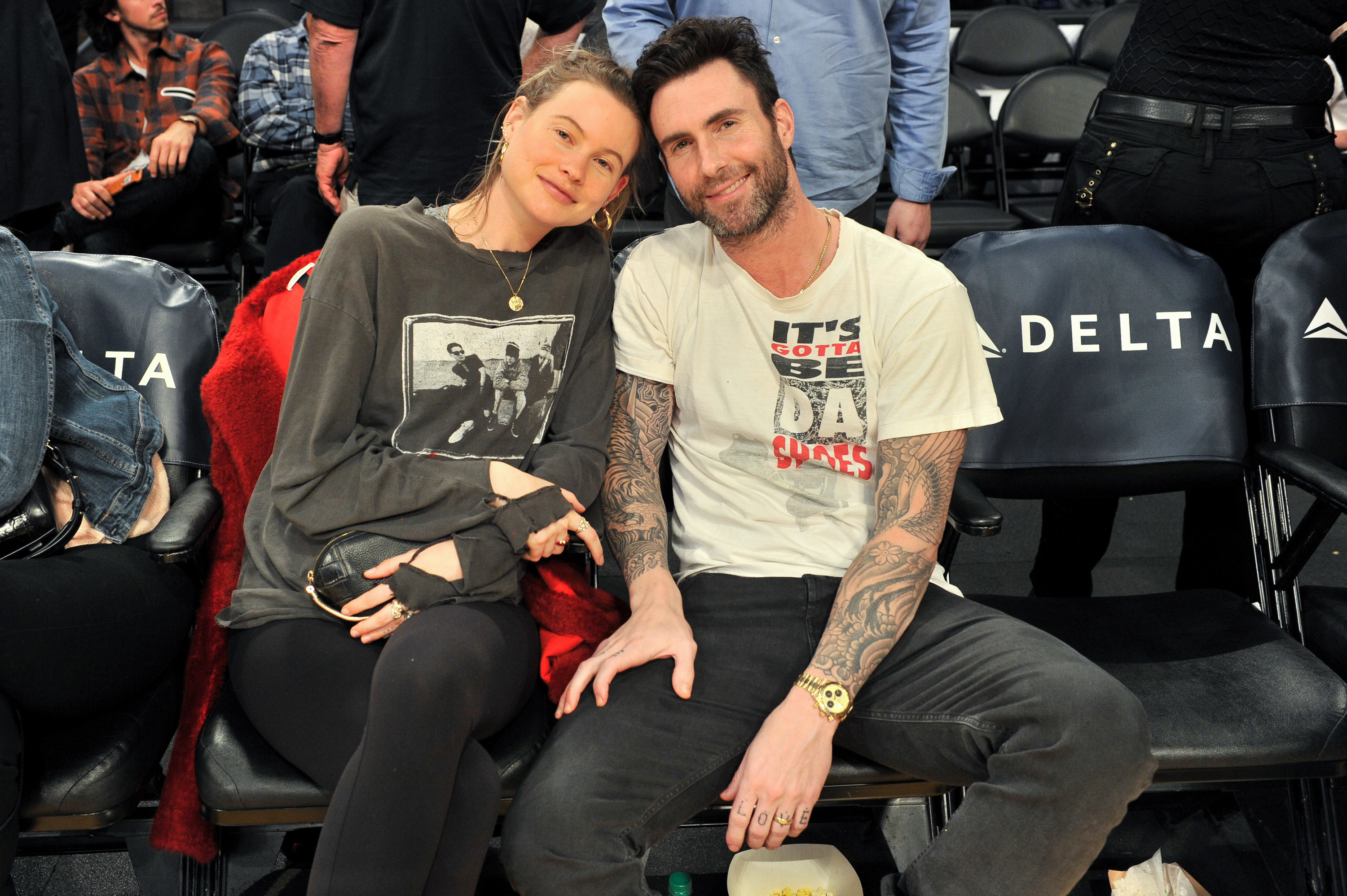 Adam Levine and Behati Prinsloo attend a basketball game between the Los Angeles Lakers and the Houston Rockets at Staples Center in Los Angeles on Dec. 3, 2017.