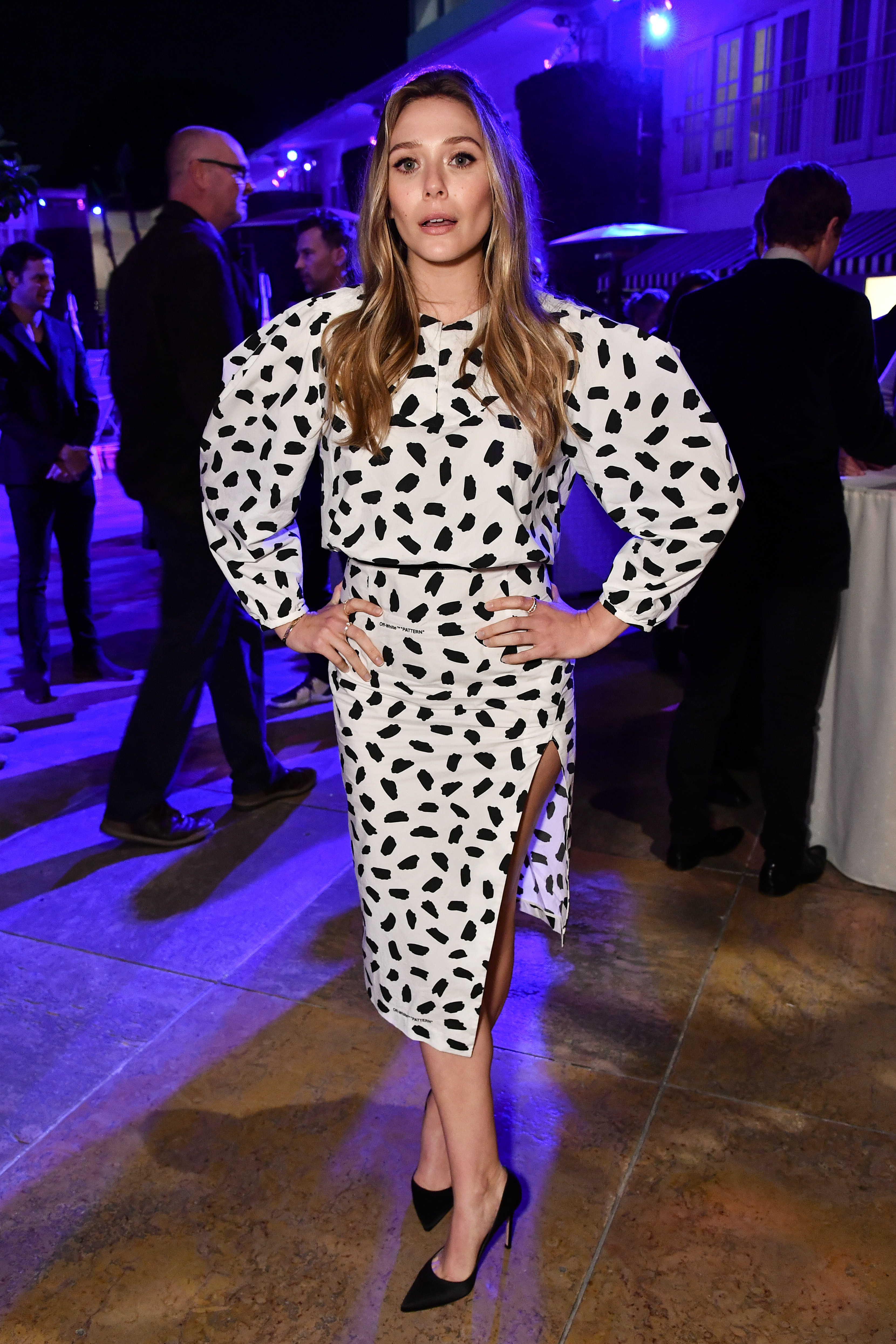 """Elizabeth Olsen attends the Nicole Sheridan """"Wind River"""" cocktail party in Los Angeles on Dec. 2, 2017."""