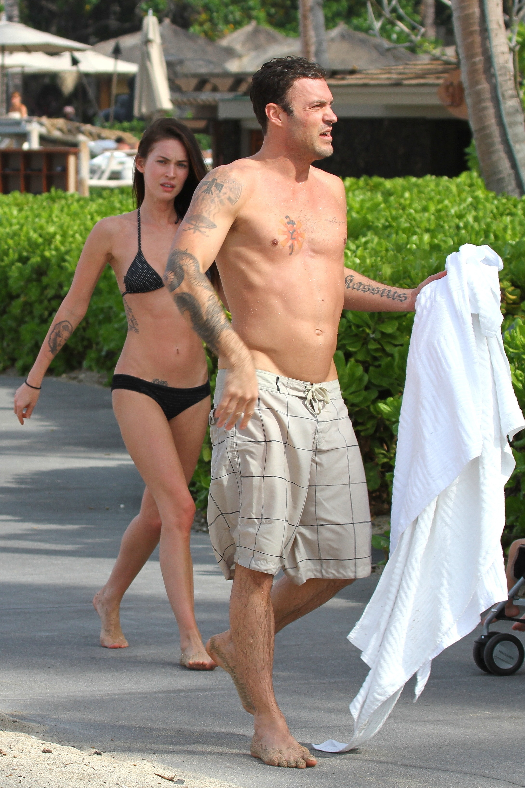 Megan Fox in bikini with husband Brian Austin Green while they holiday in Hawaii in December 2010.